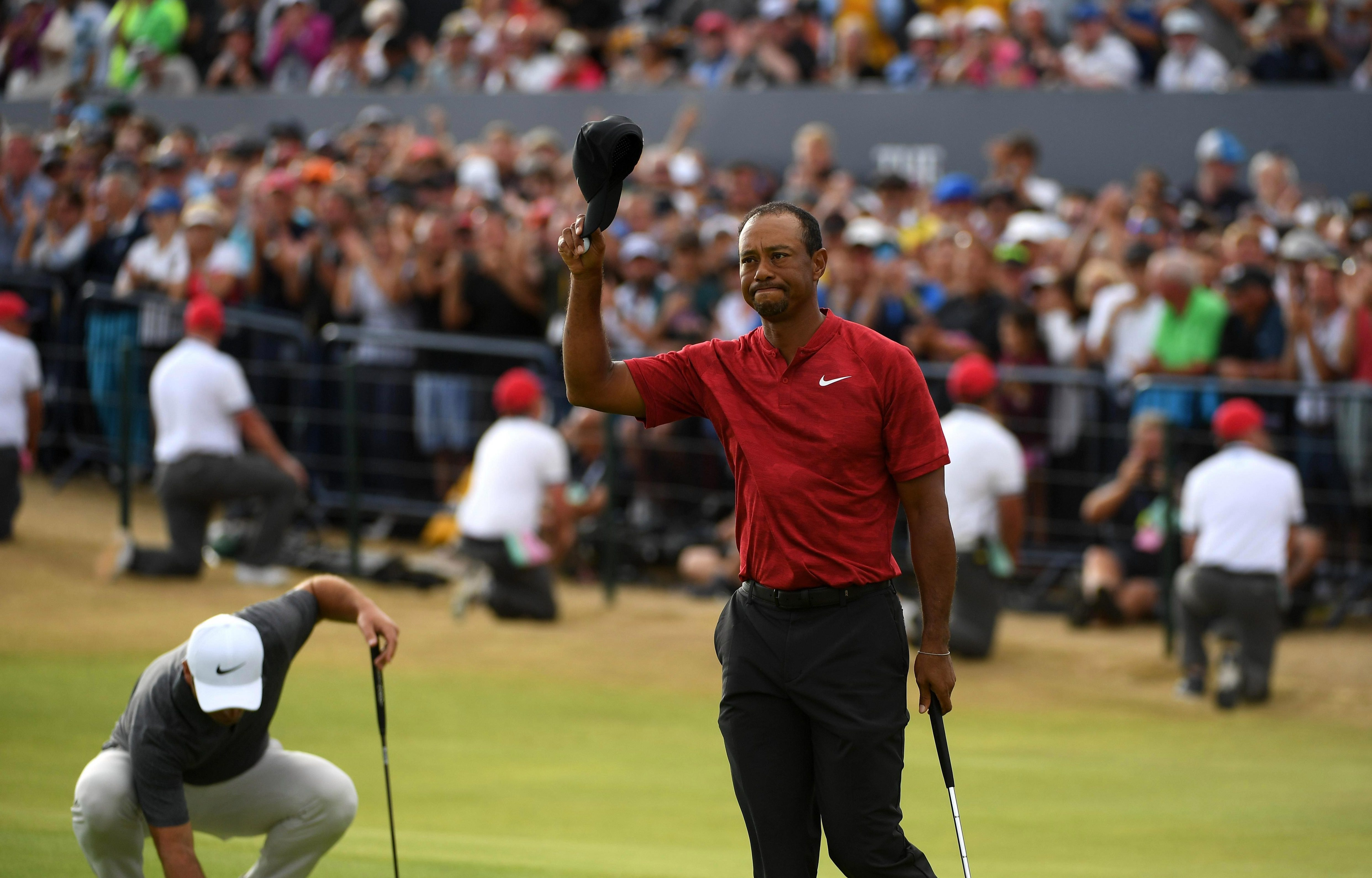 Woods applauds the fans in attendance at The Open after he tied in sixth place