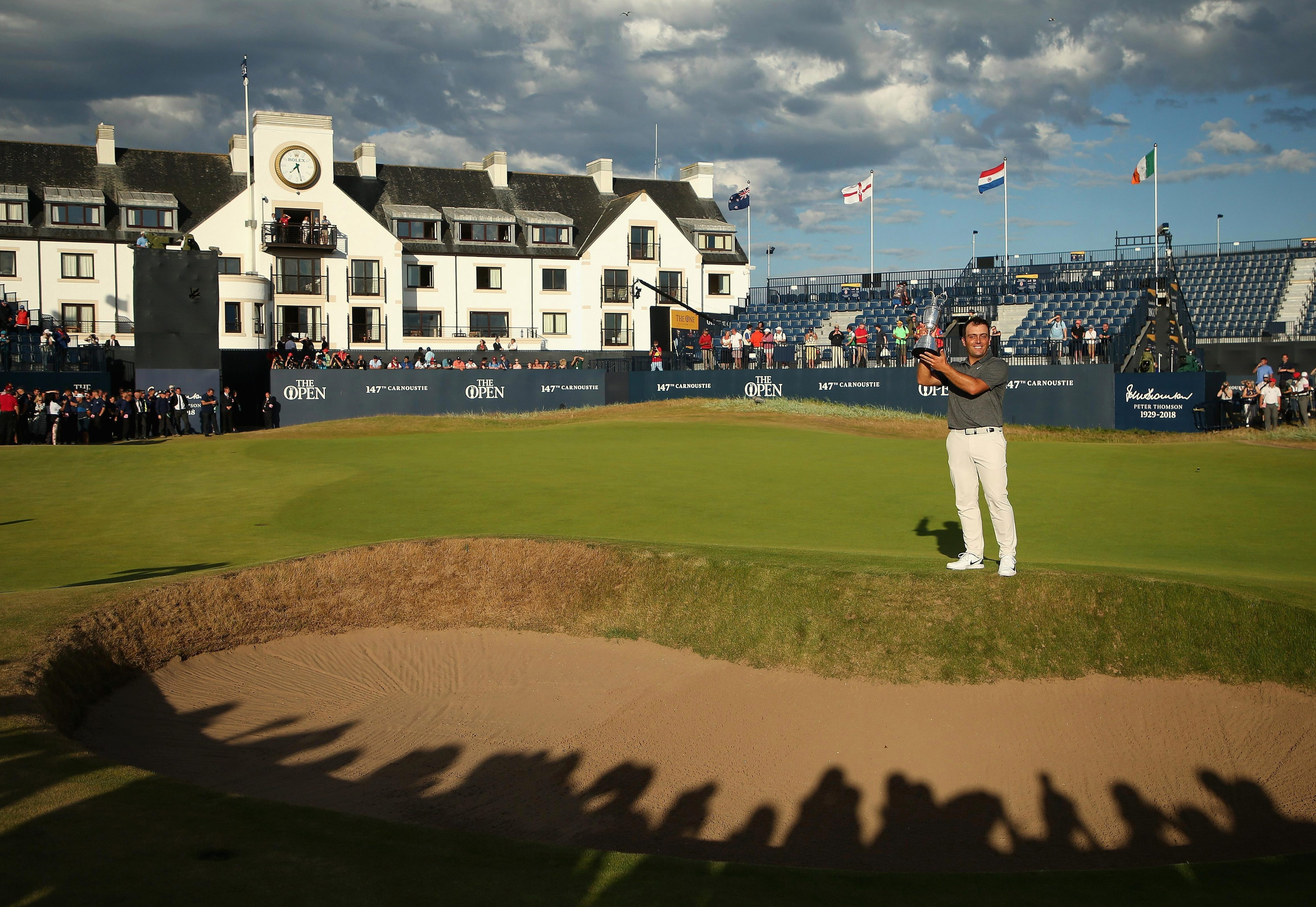West Ham supporter Francesco Molinari came out of the shadows to become the first Italian to win a Major, finishing two shots clear of four players at Carnoustie