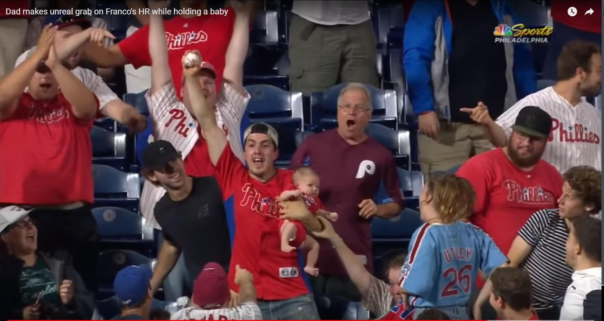 The Philadelphia fan had his son in his left hand and the ball in his right