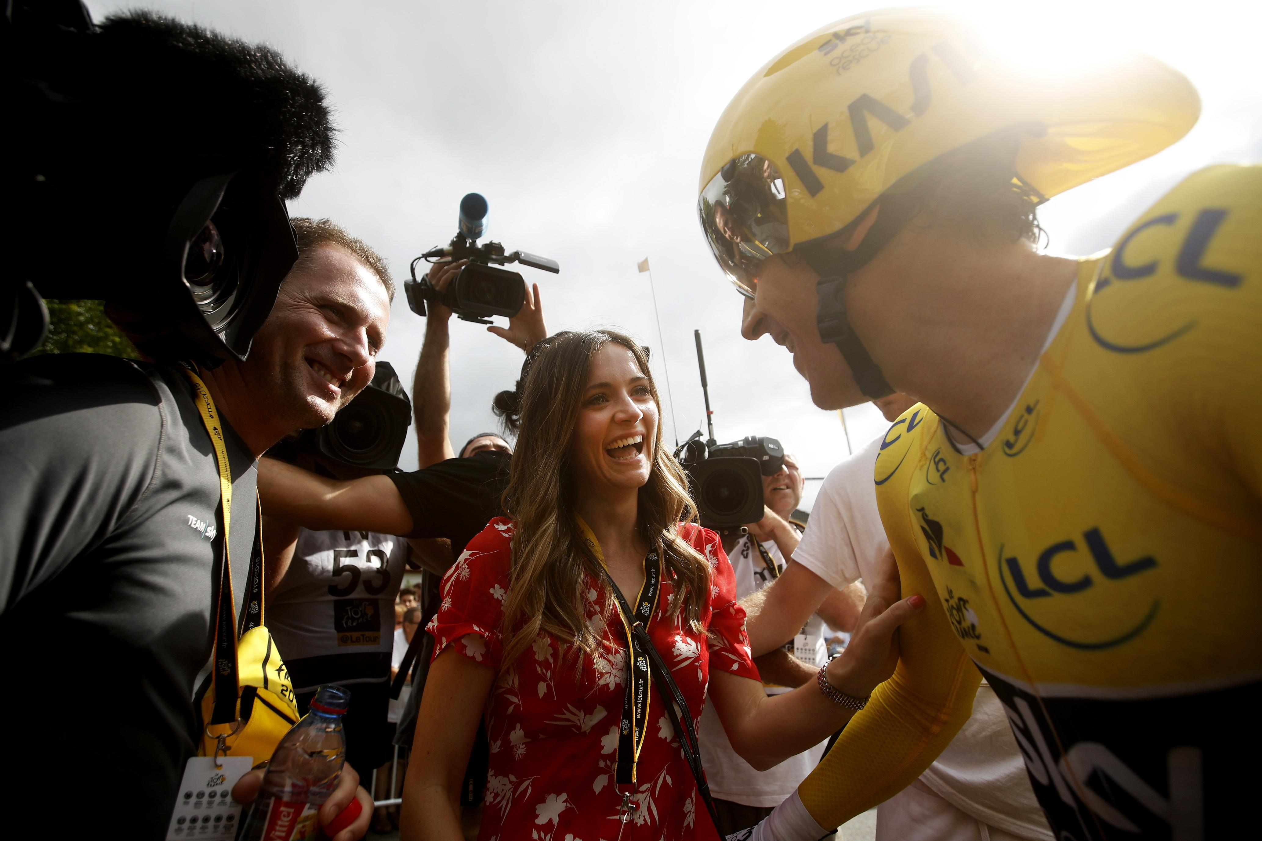 Sarah Elen Thomas celebrates with husband Geraint after the 20th stage of the Tour de France race