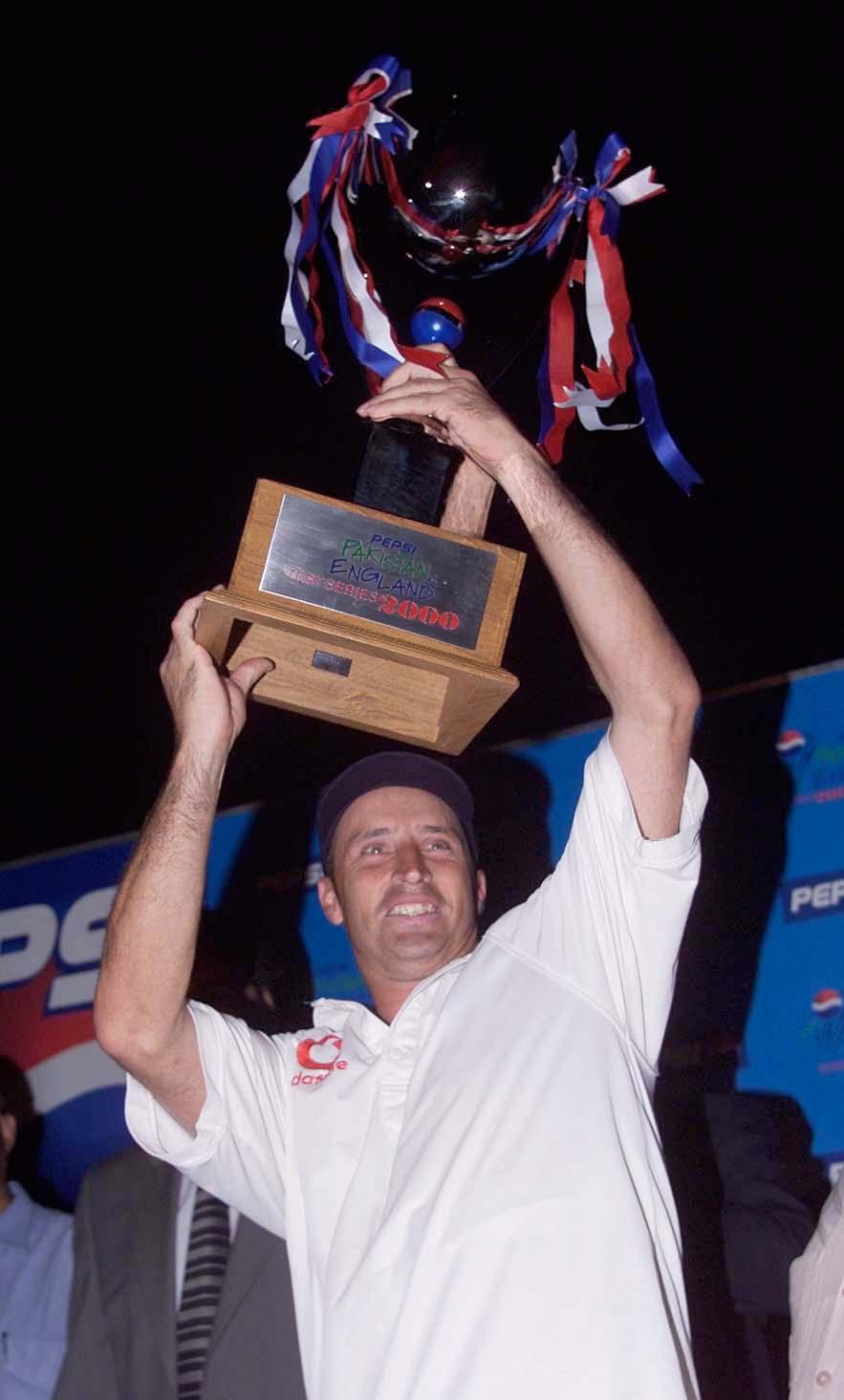 Nasser Hussain lifts the trophy in the dark after a impressive win in Karachi