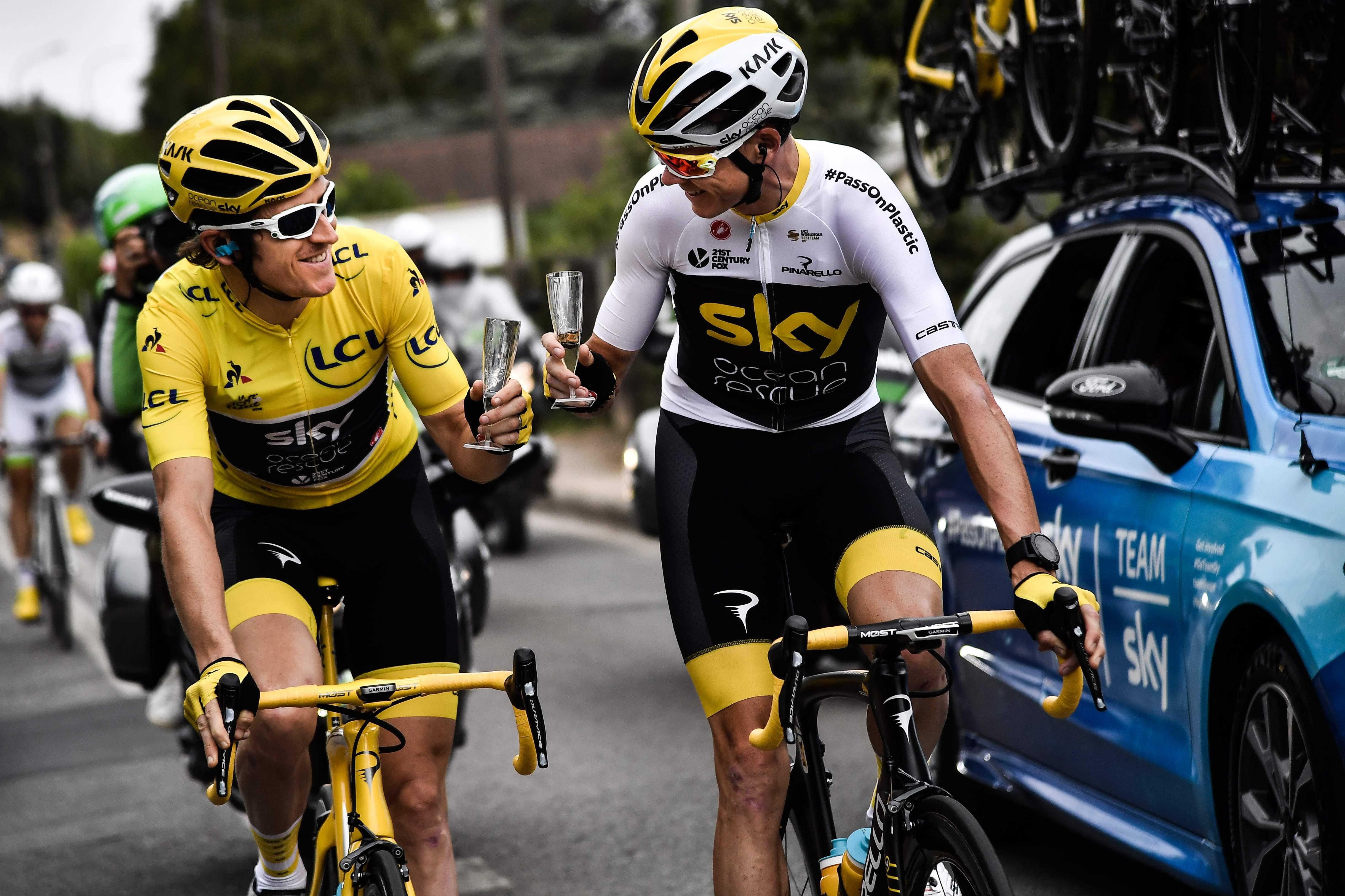 Thomas and pal Chris Froome cheers each other after securing first and third on the Tour podium