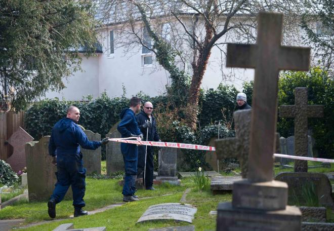 Police investigating the churchyard of St Dunstans