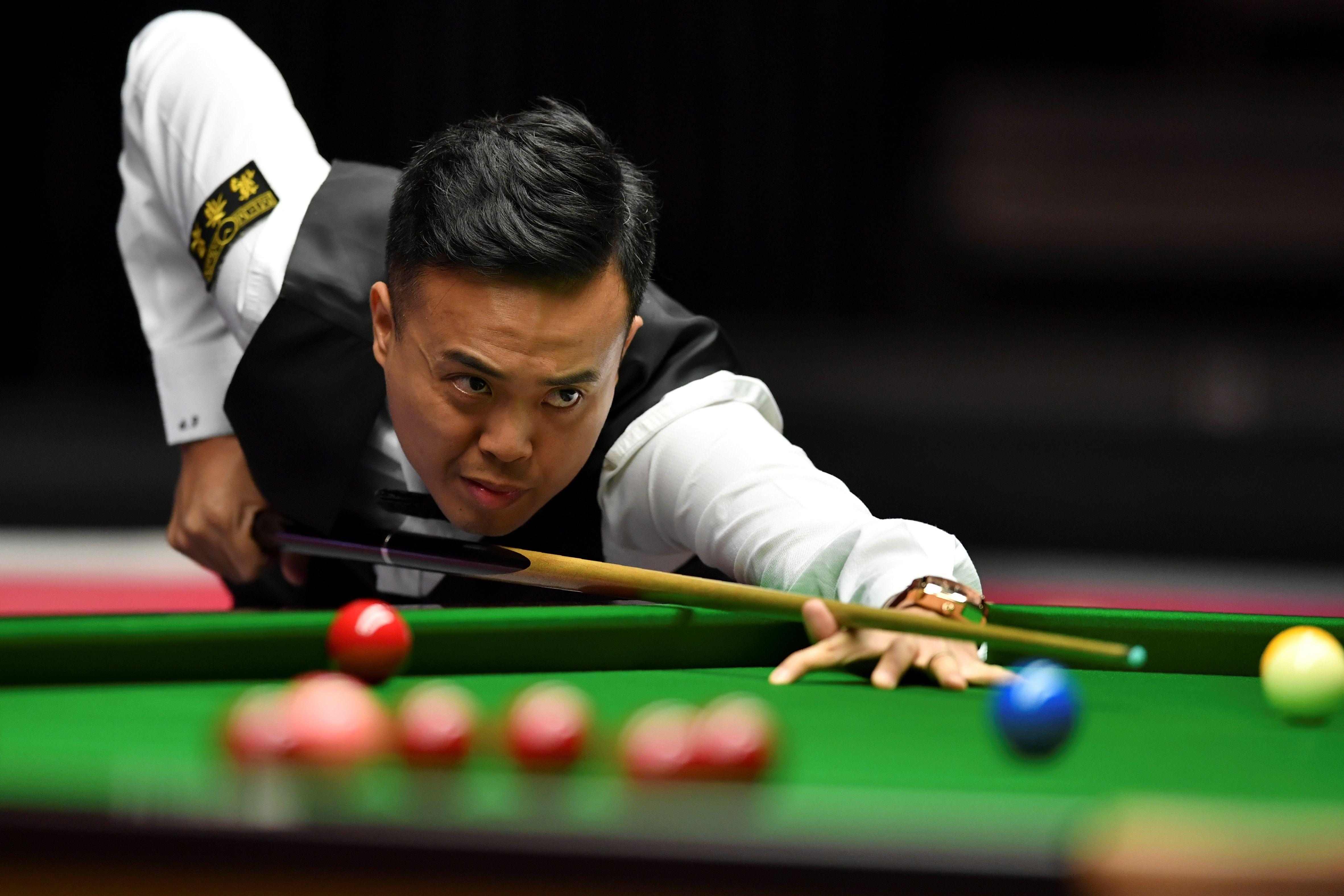 Marco Fu came out on top against veteran former world champion Peter Ebdon