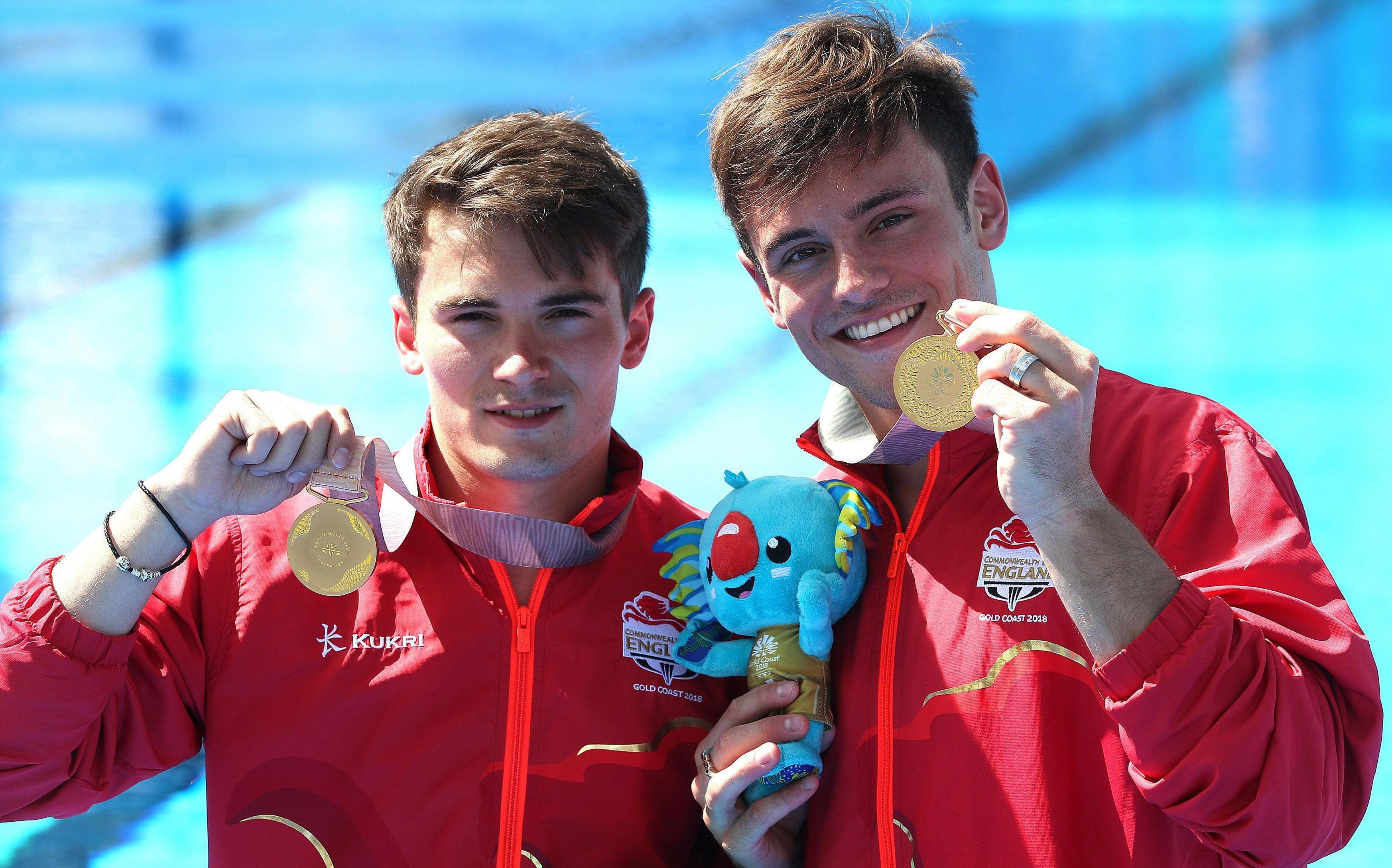 Daley and Daniel Goodfellow celebrate with gold in the men's 10metres syncro platform at the Commonwealth Games