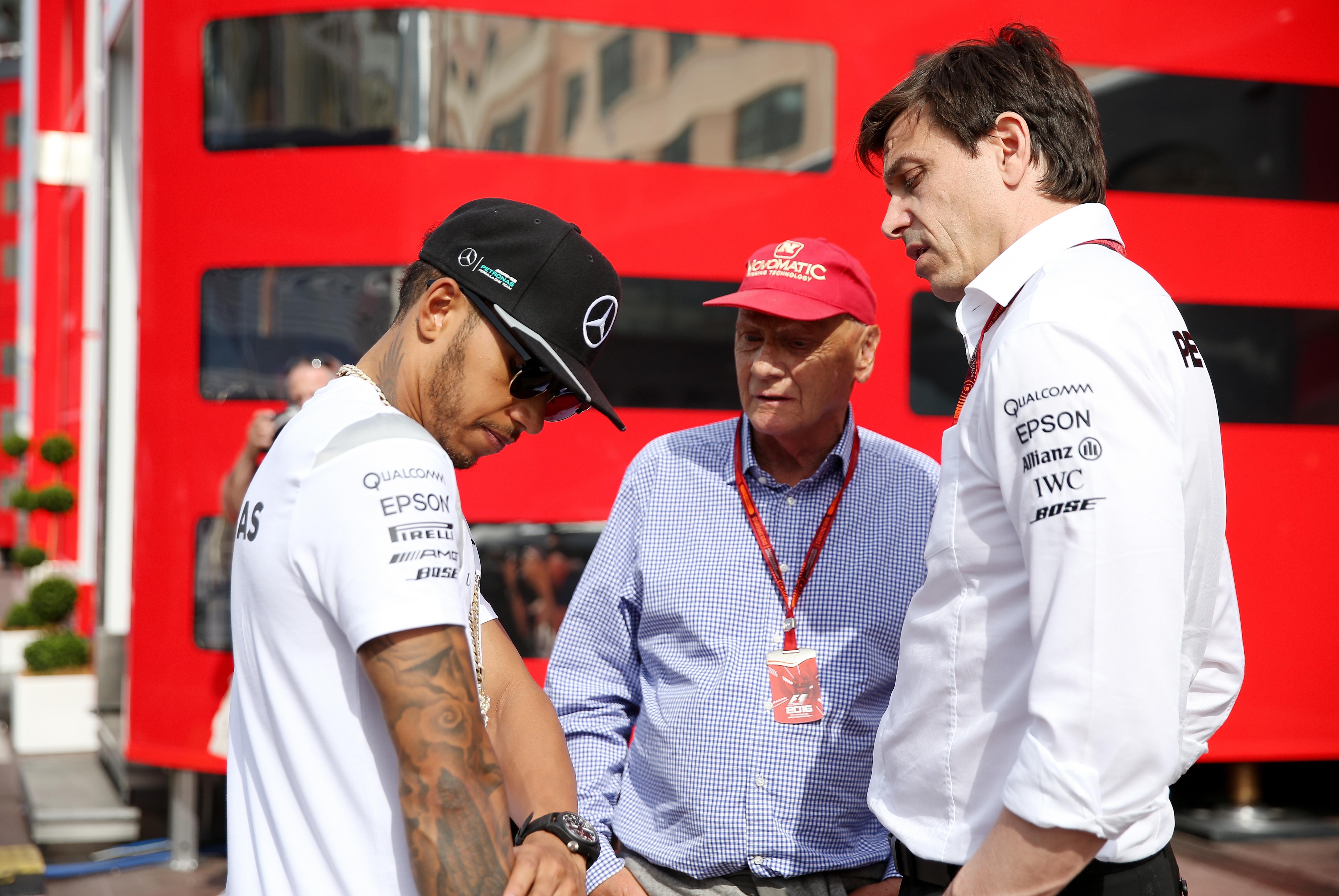 Lauda, centre, was instrumental in Mercedes hiring Lewis Hamilton, left, in 2013