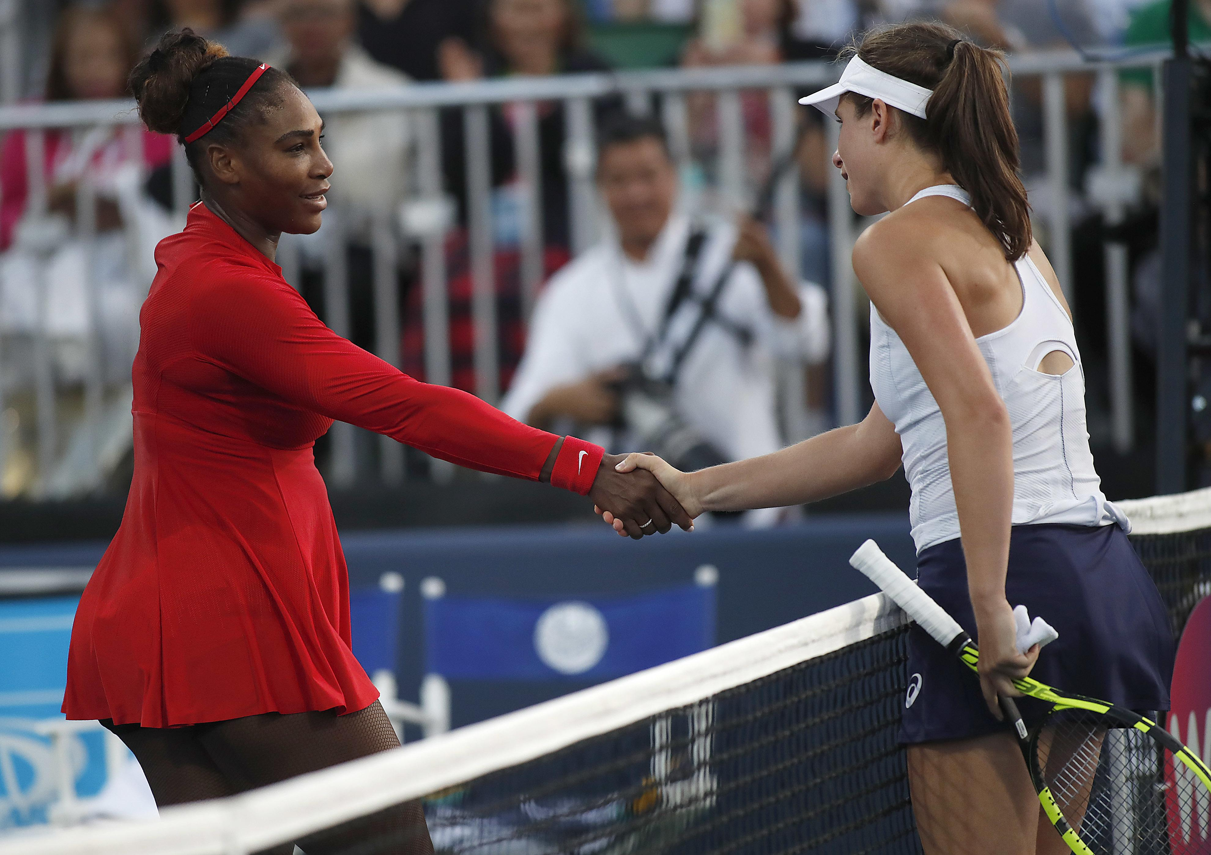 Serena Williams shakes hands with Johanna Konta at the end of the match