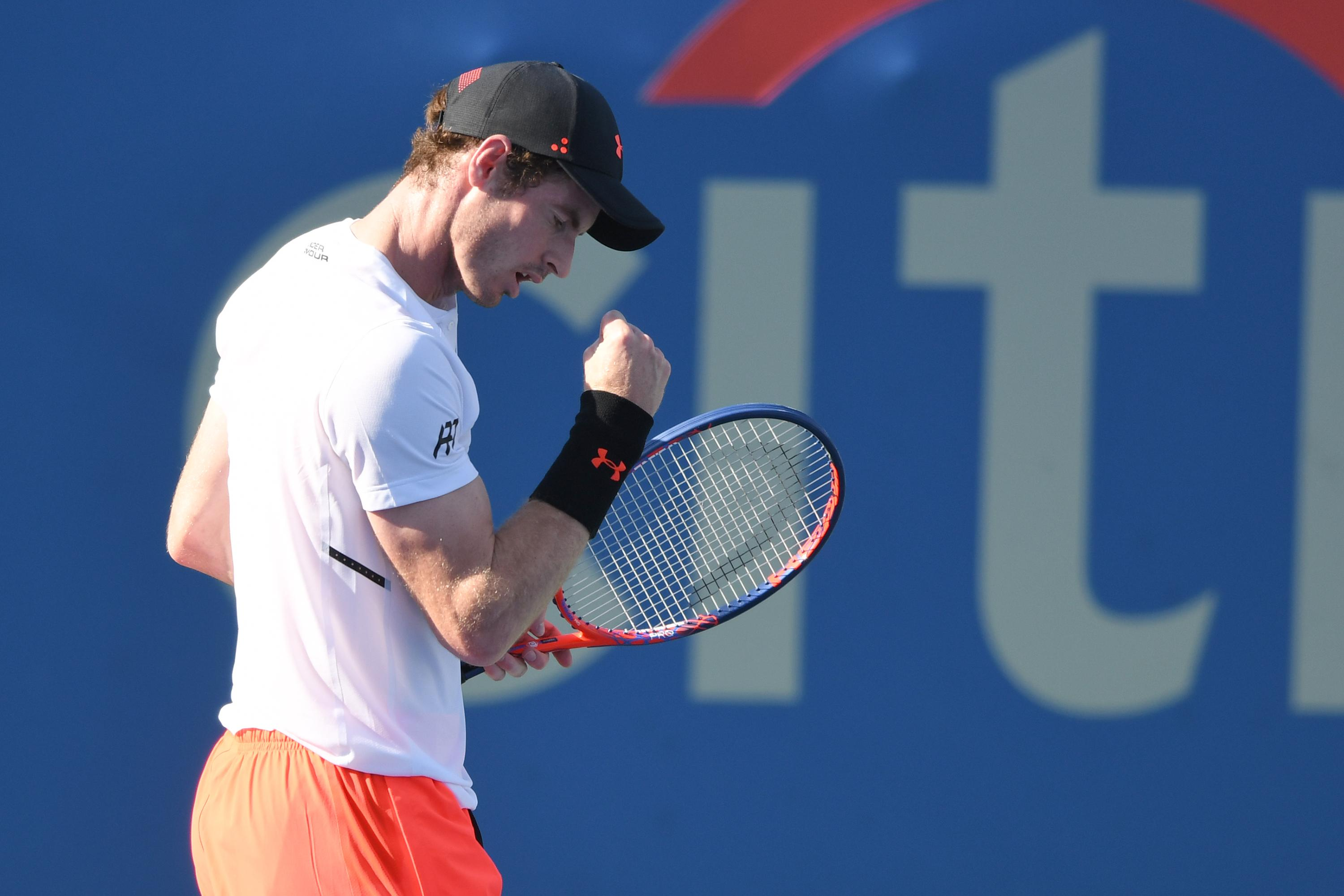Andy Murray celebrates after taking the first set 7-6