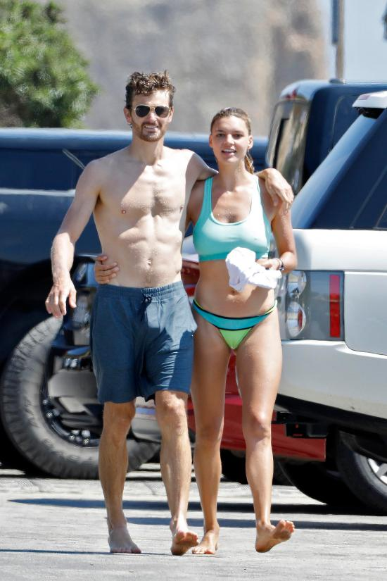Kelly Rohrbach and Steuart Walton relax arm in arm after a tough workout in Malibu, LA