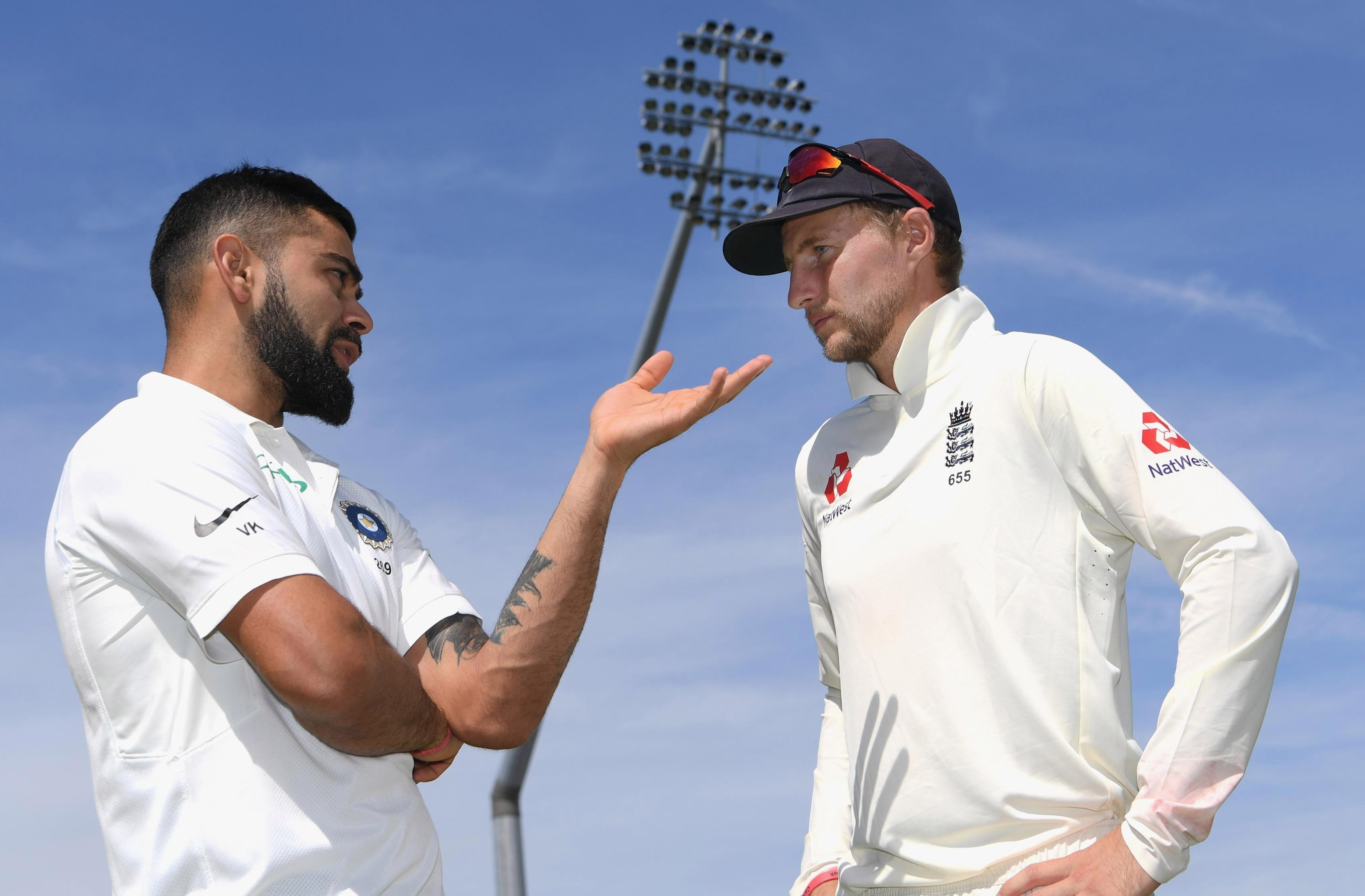 England skipper Joe Root talks over the Edgbaston opener - which lasted four days - with his India counterpart Virat Kohli