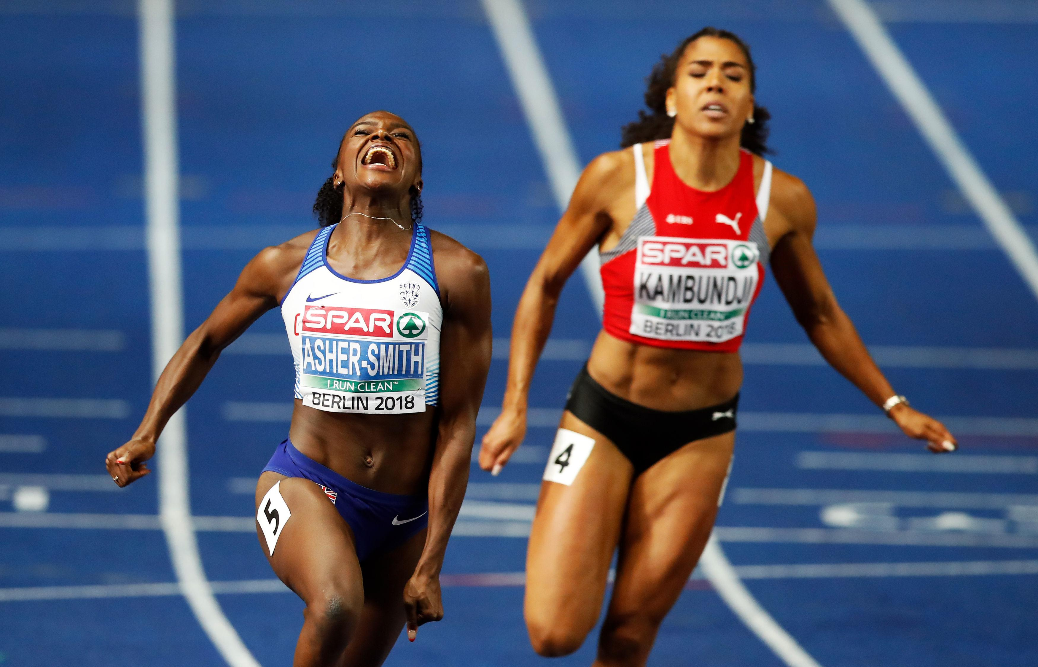 Dina Asher-Smith crosses the line in a British record time of 10.85sec to clinch European gold