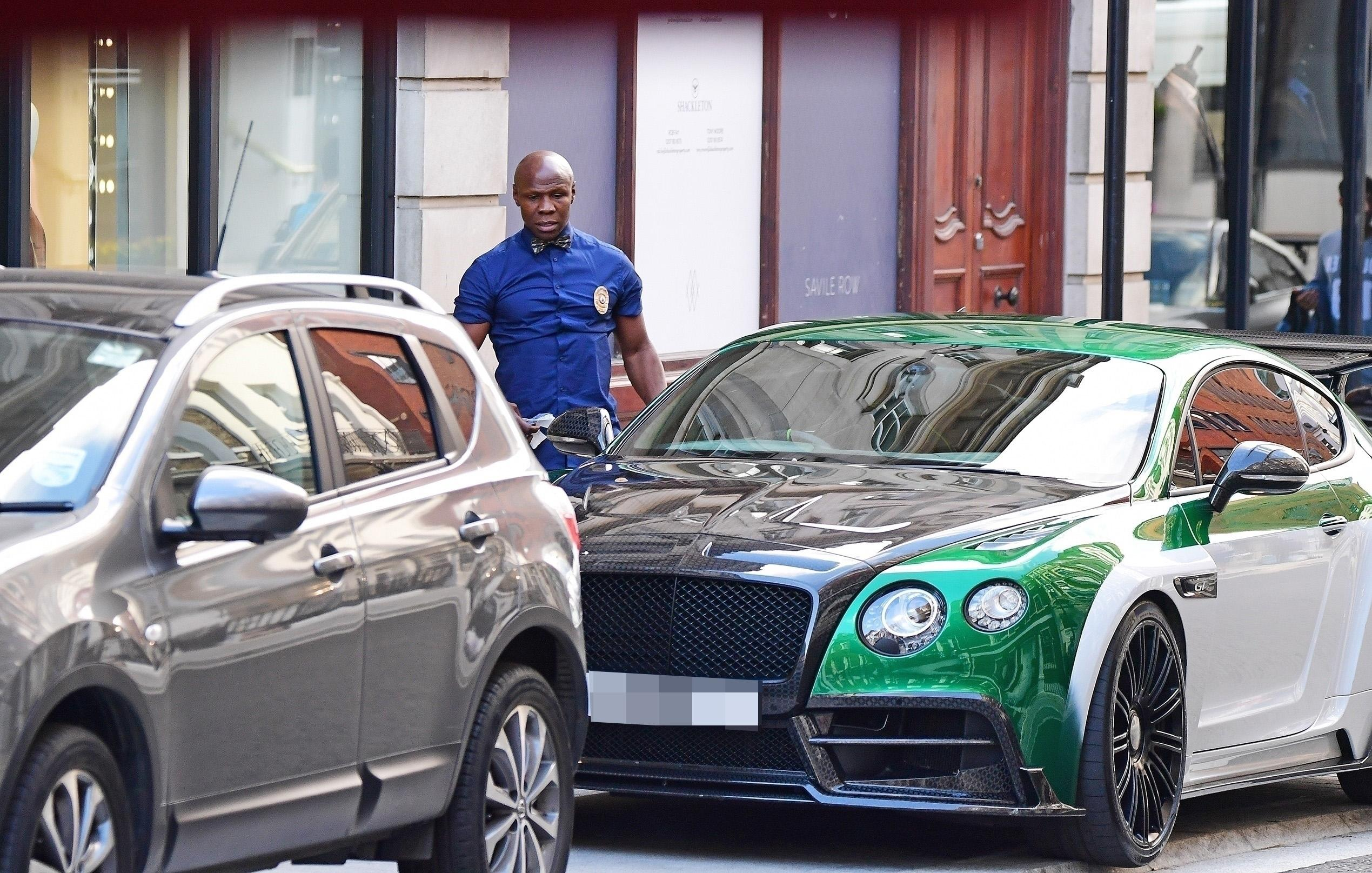 Chris ensured he had heads turning as he turned up on Savile Row in his flashy Bentle