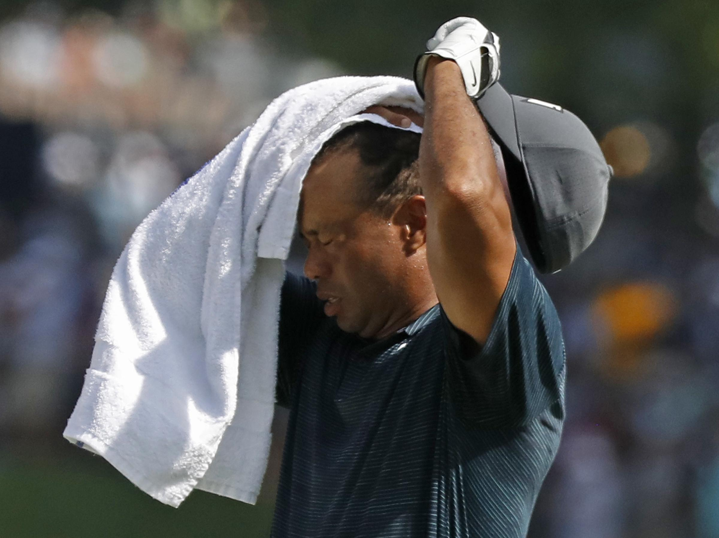 Tiger Woods played better after changing his shirt, firing a level par round of 70