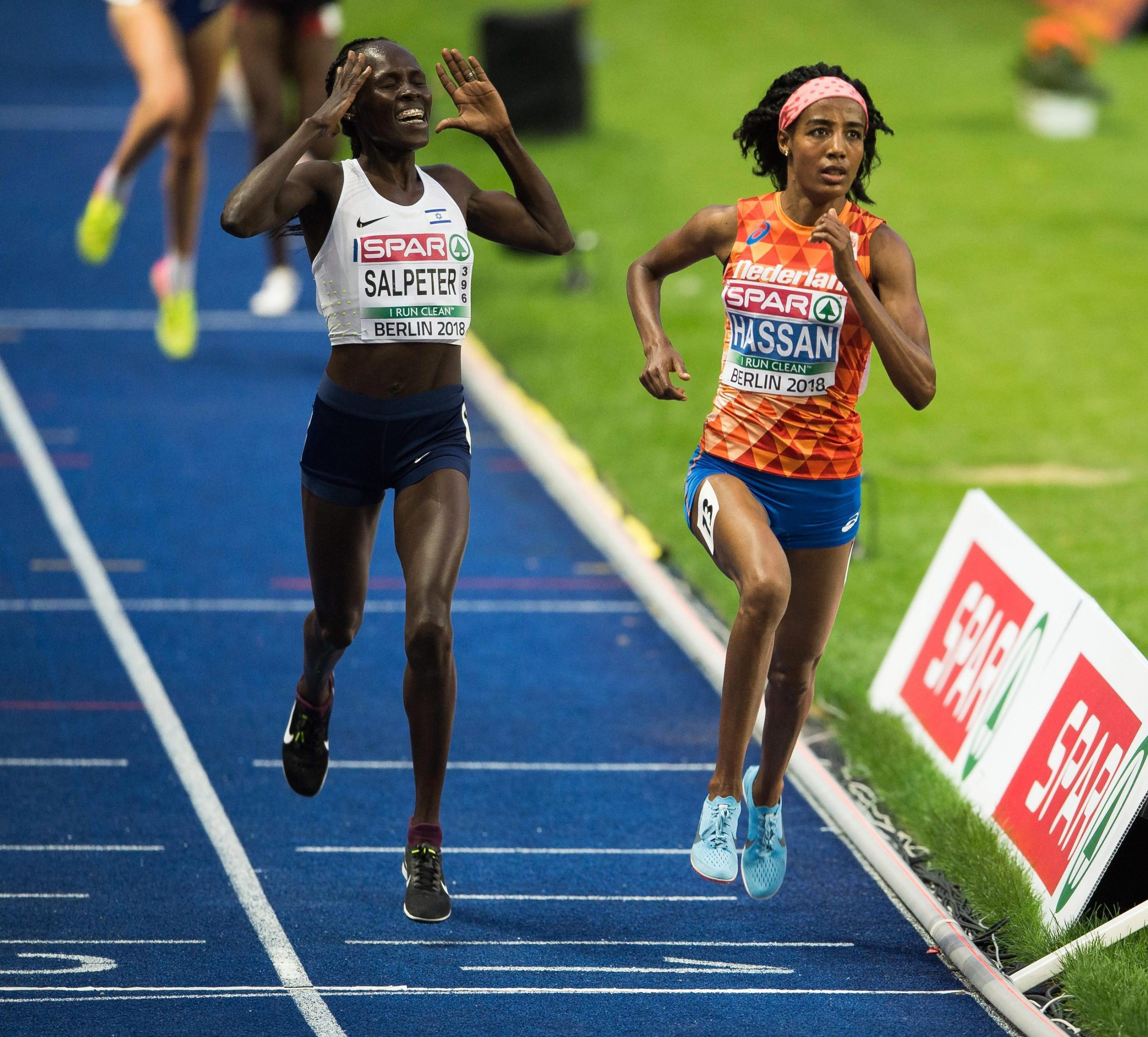 Lonah Salpeter throws up her hands in short-lived joy as she thinks the race is over and that she has won silver