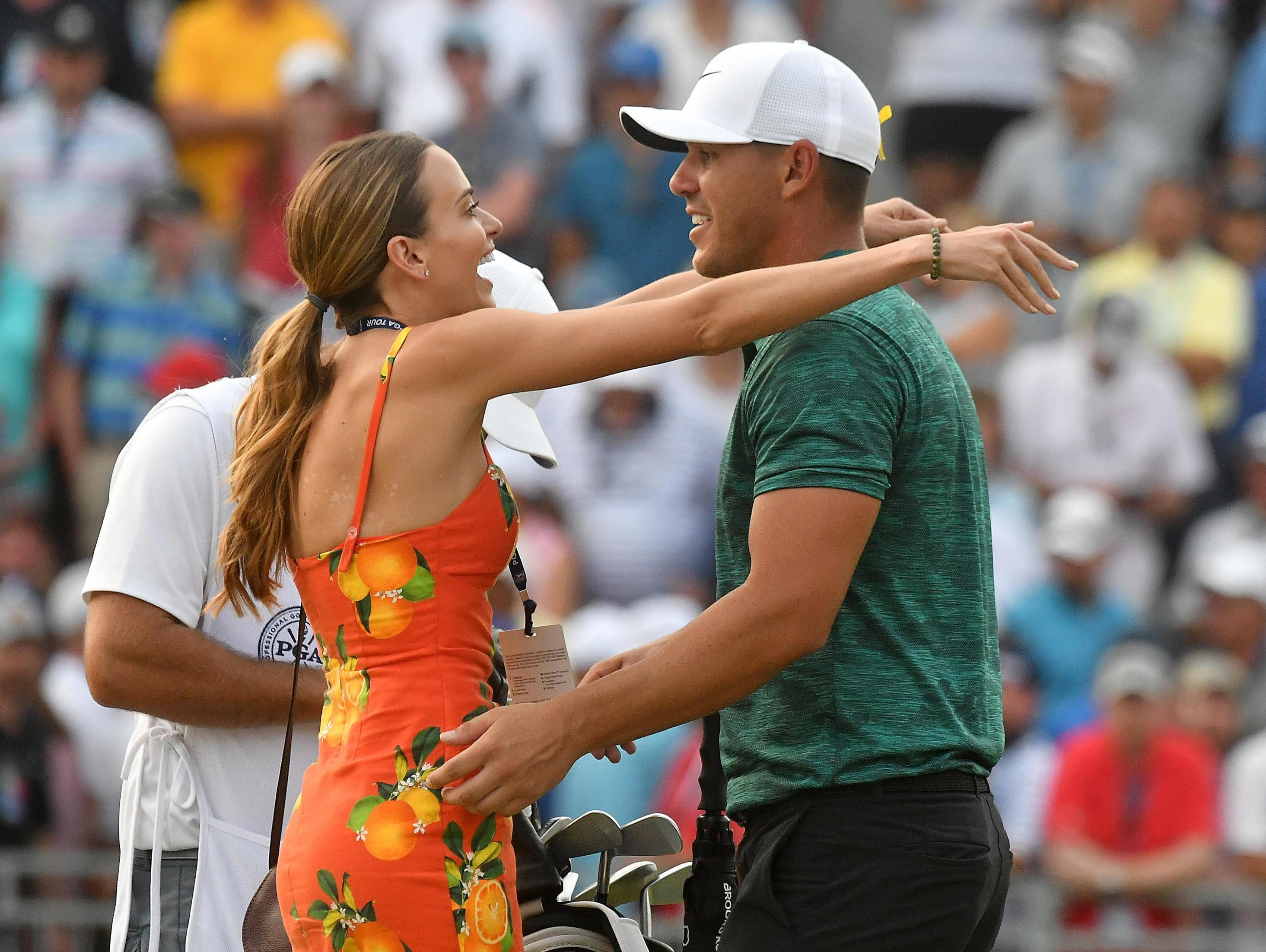 American star Brooks Koepka gets to celebrate his win with an embrace from actress and model girlfriend Jena Sims