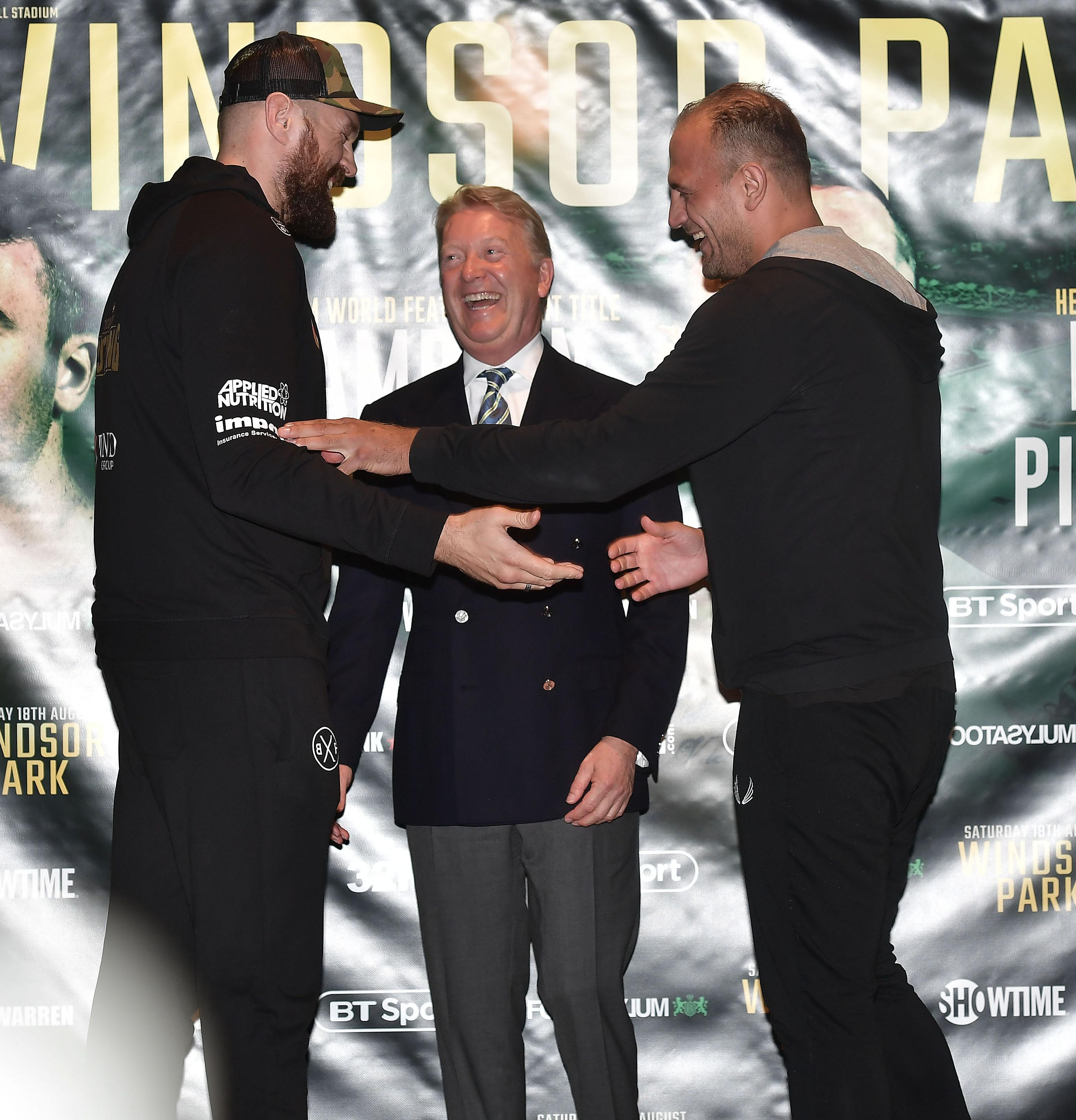 Frank Warren is the middle man as Tyson Fury takes a gentle dig in the ribs from Italian opponent Francesco Pianeta