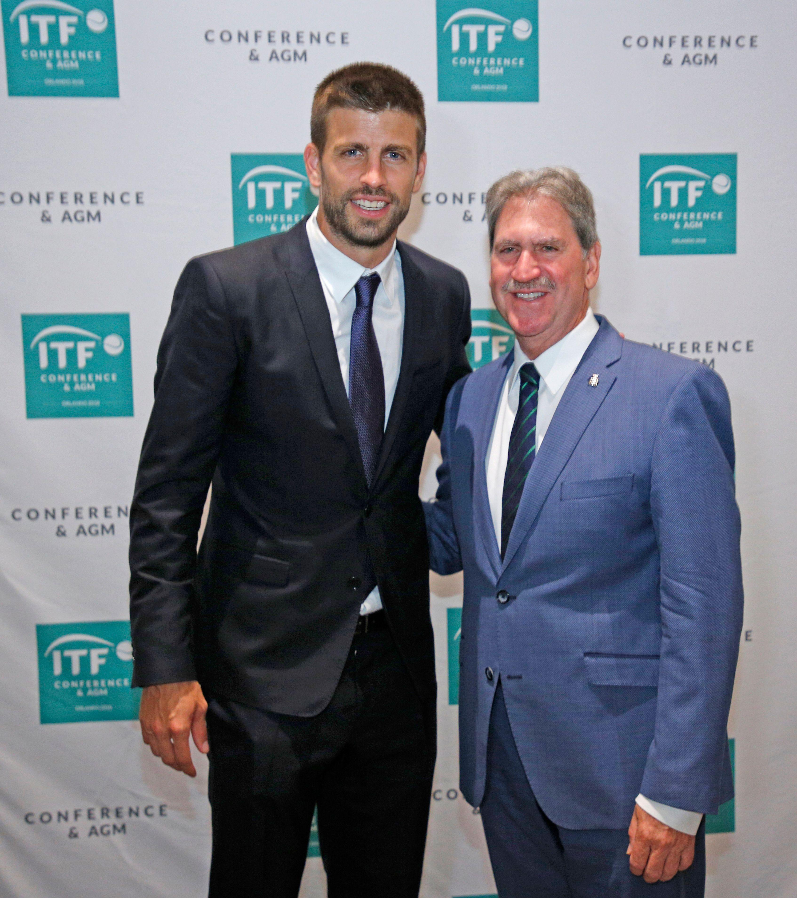 Gerard Pique and David Haggerty President of International Tennis Federation after rubber stamping Davis Cup changes