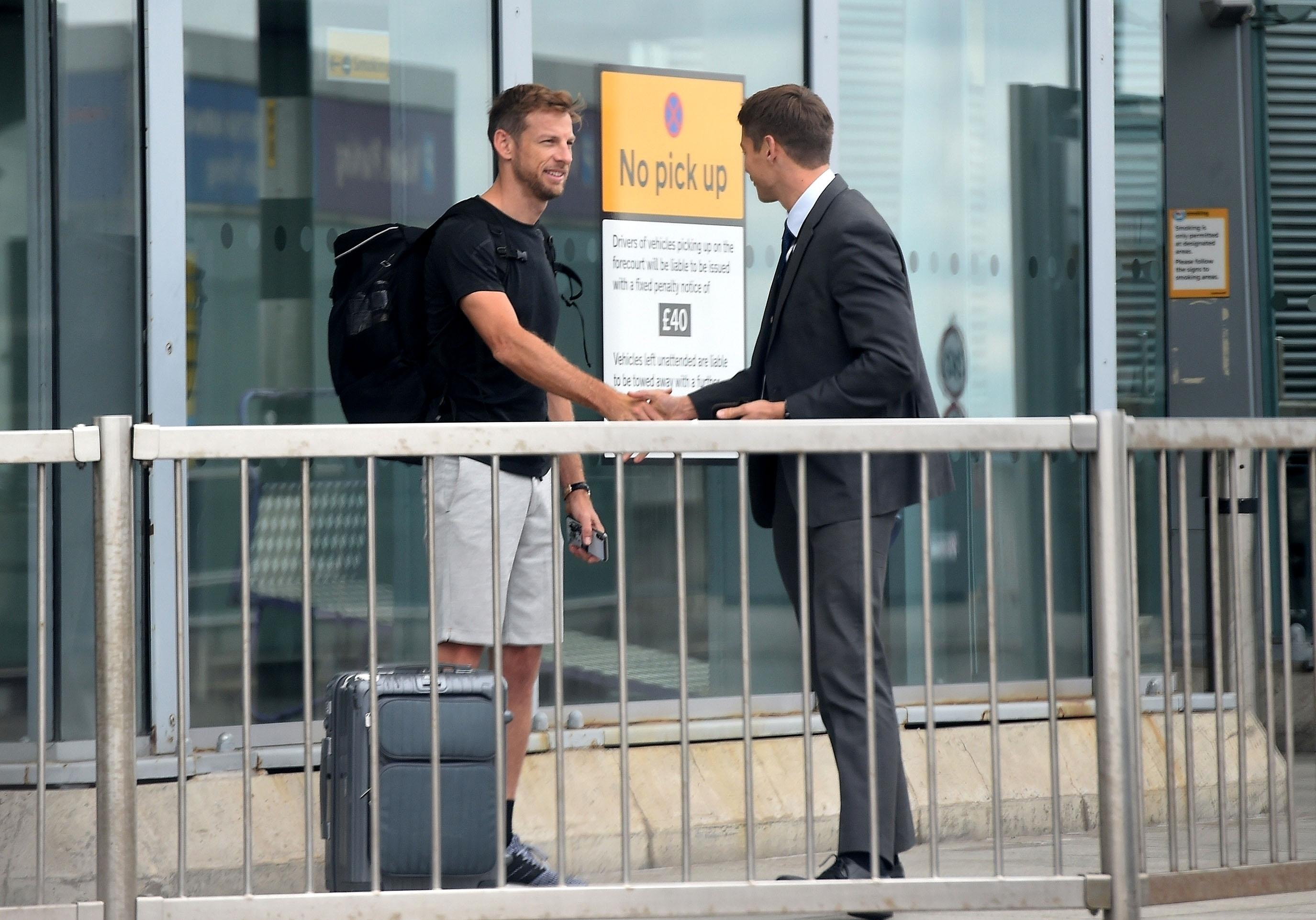 Jenson was greeted at the airport before being taken to his new McLaren