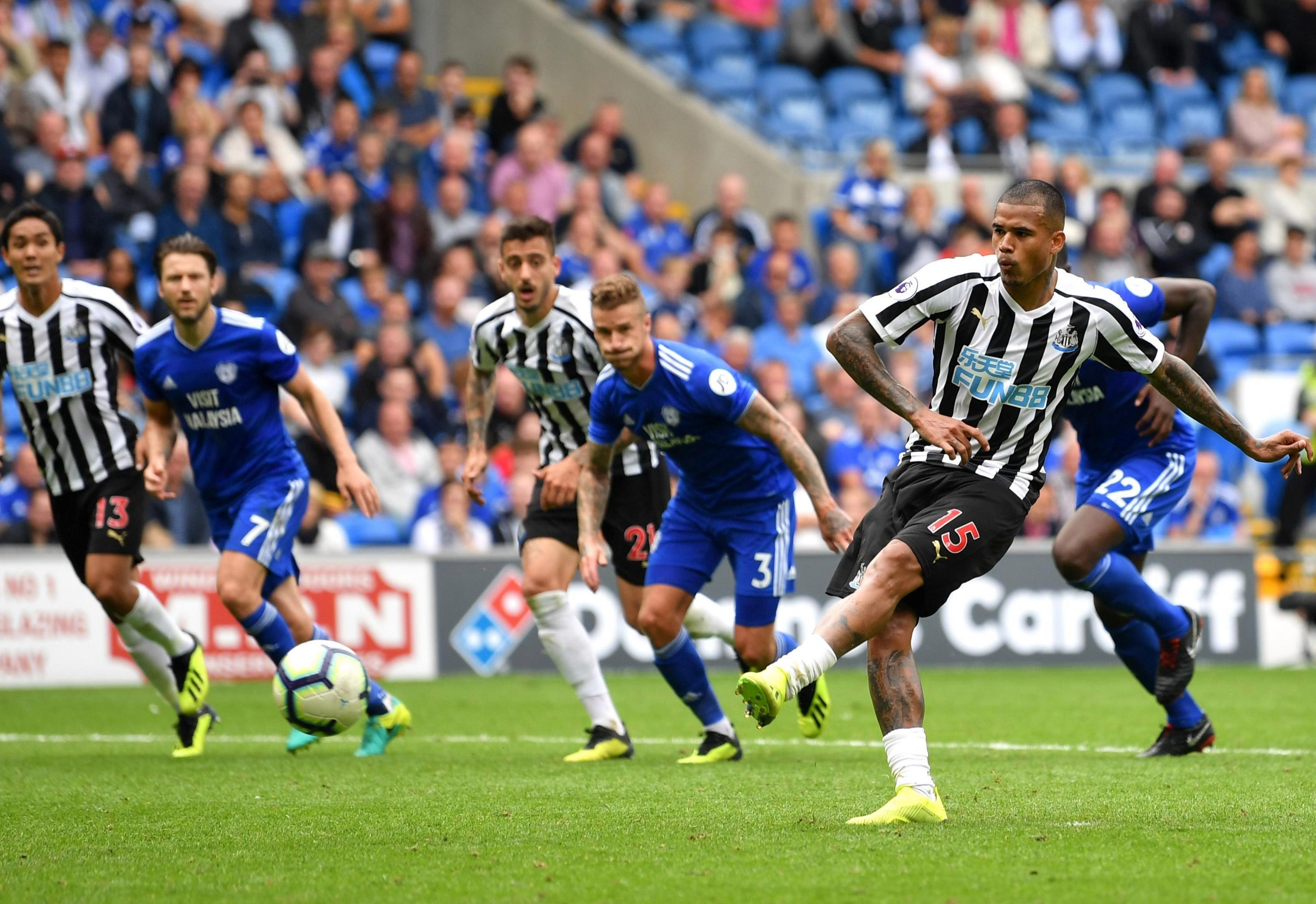 Kenedy fires his penalty towards the goal in the 94th minute