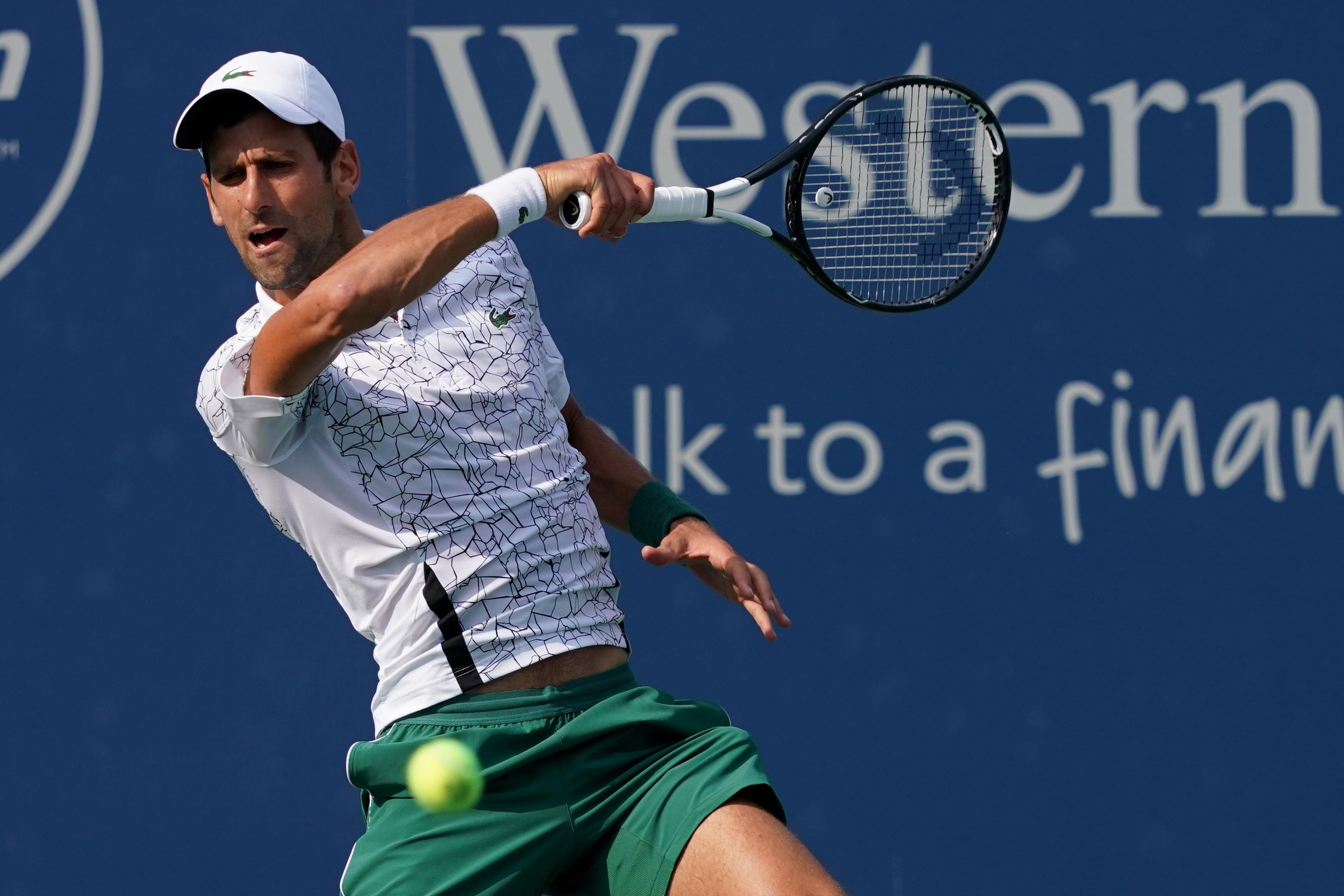 The Serb closed out victory on serve as Federer sailed wide on match point