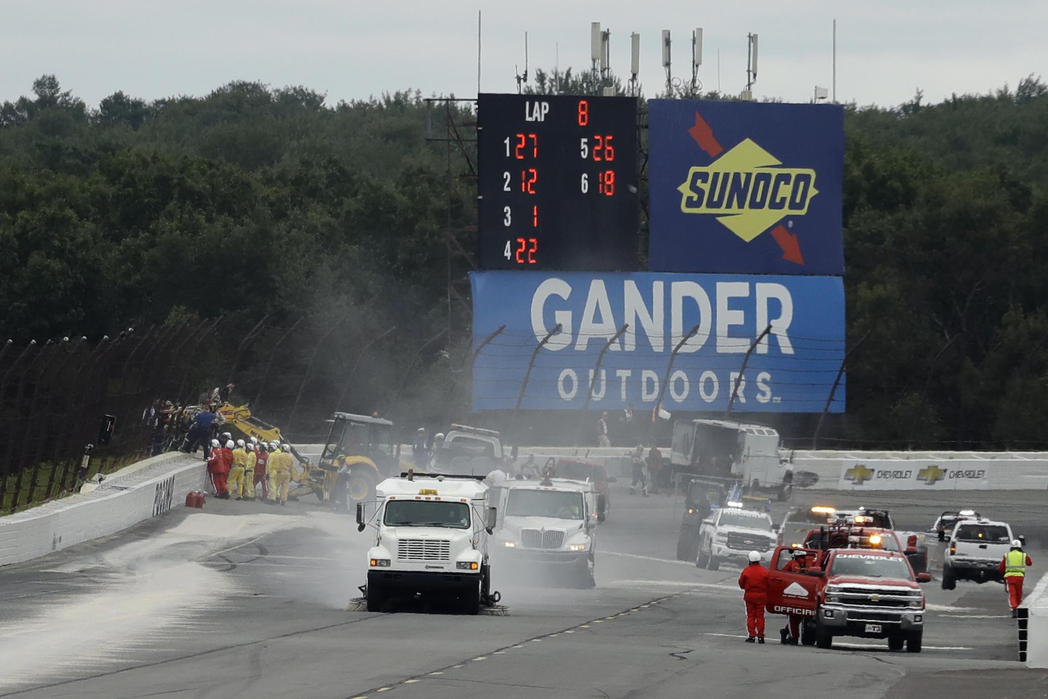 Track workers repair a section of fence after the crash