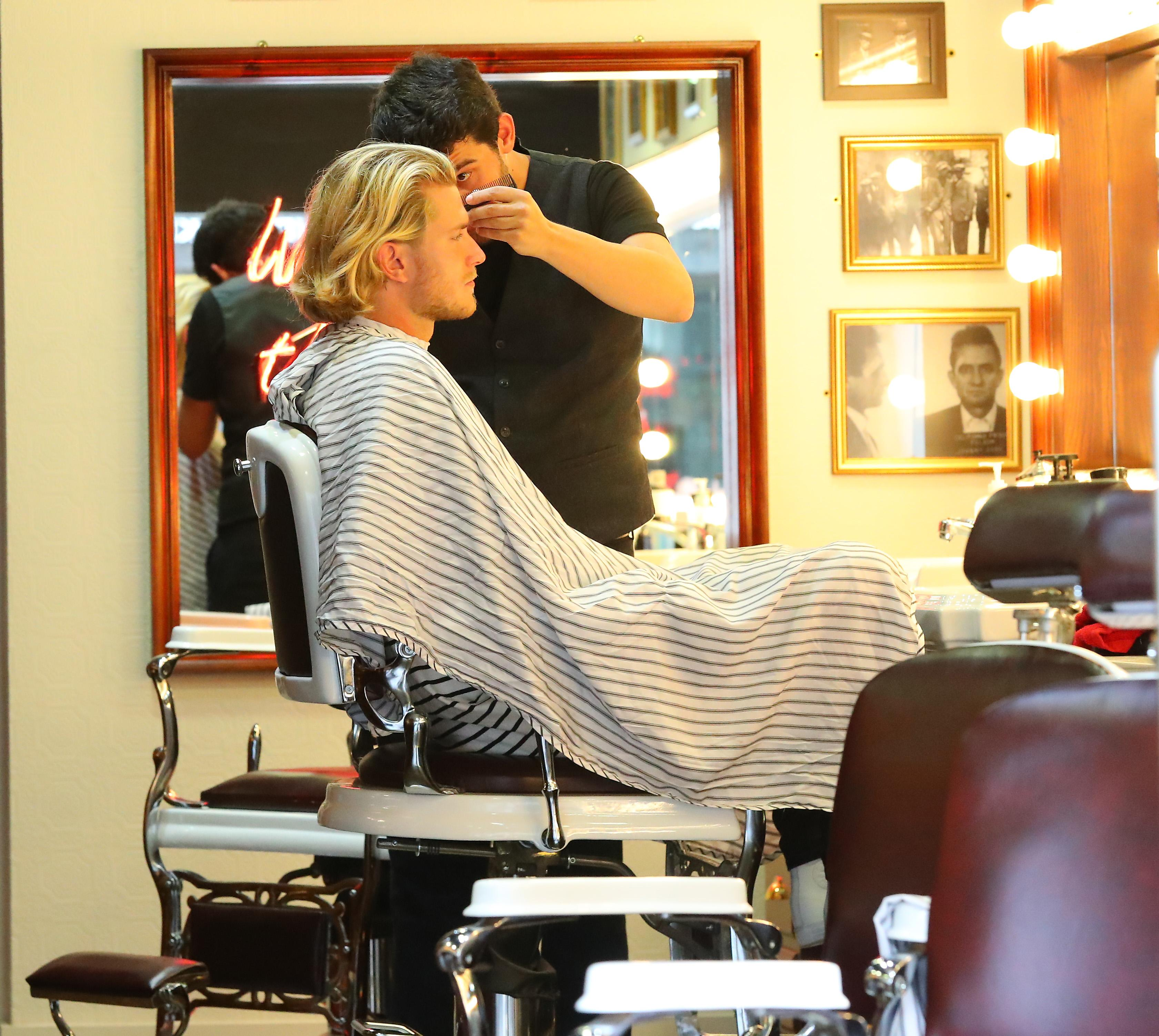 Loris Karius enjoyed a haircut at Barber Barber in Hale Village on Wednesday