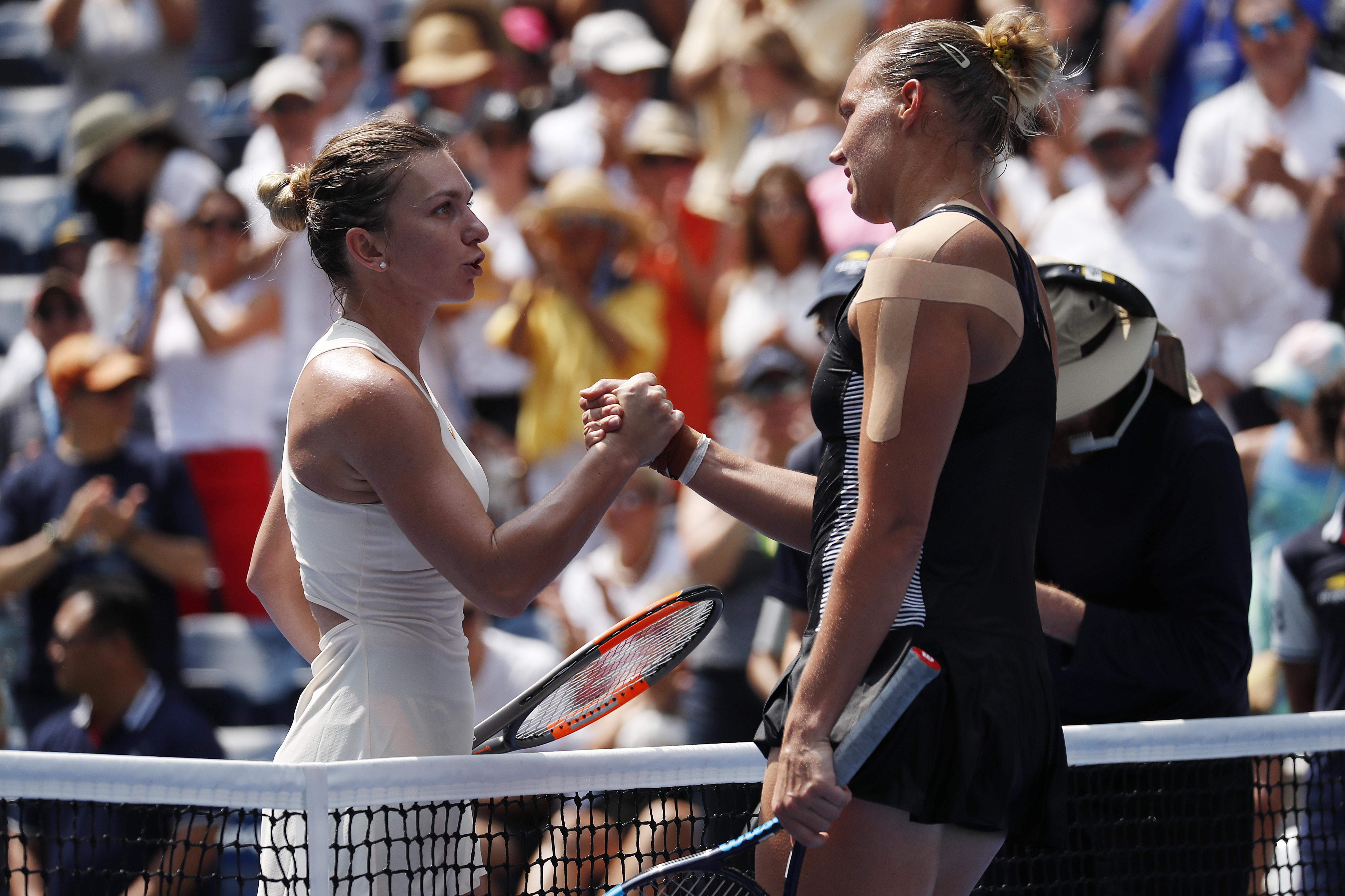 Halep, 26, embraces Kanepi following their match at the US Open