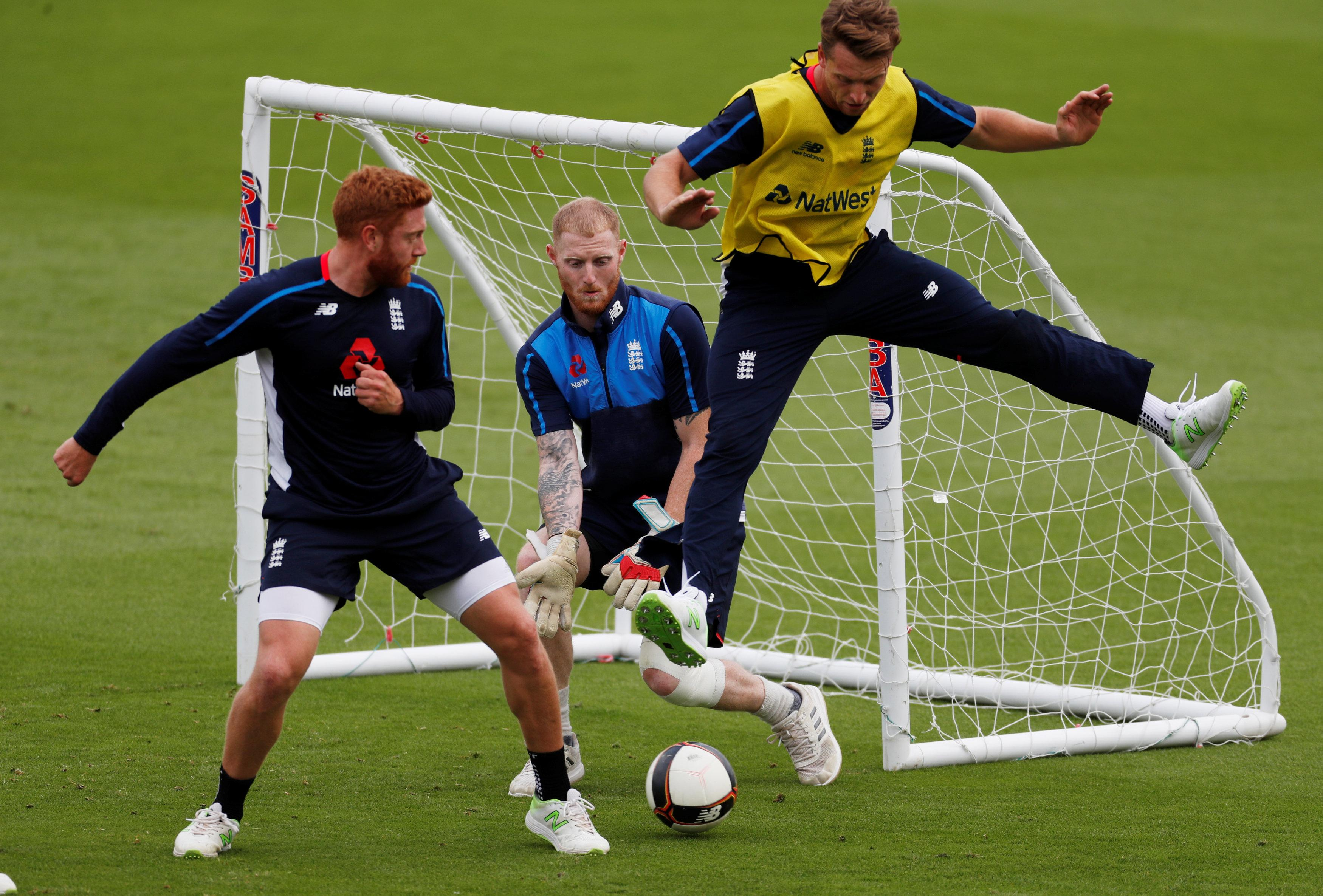 Stokes, Buttler and Bairstow warm up for their practice session with a kickabout