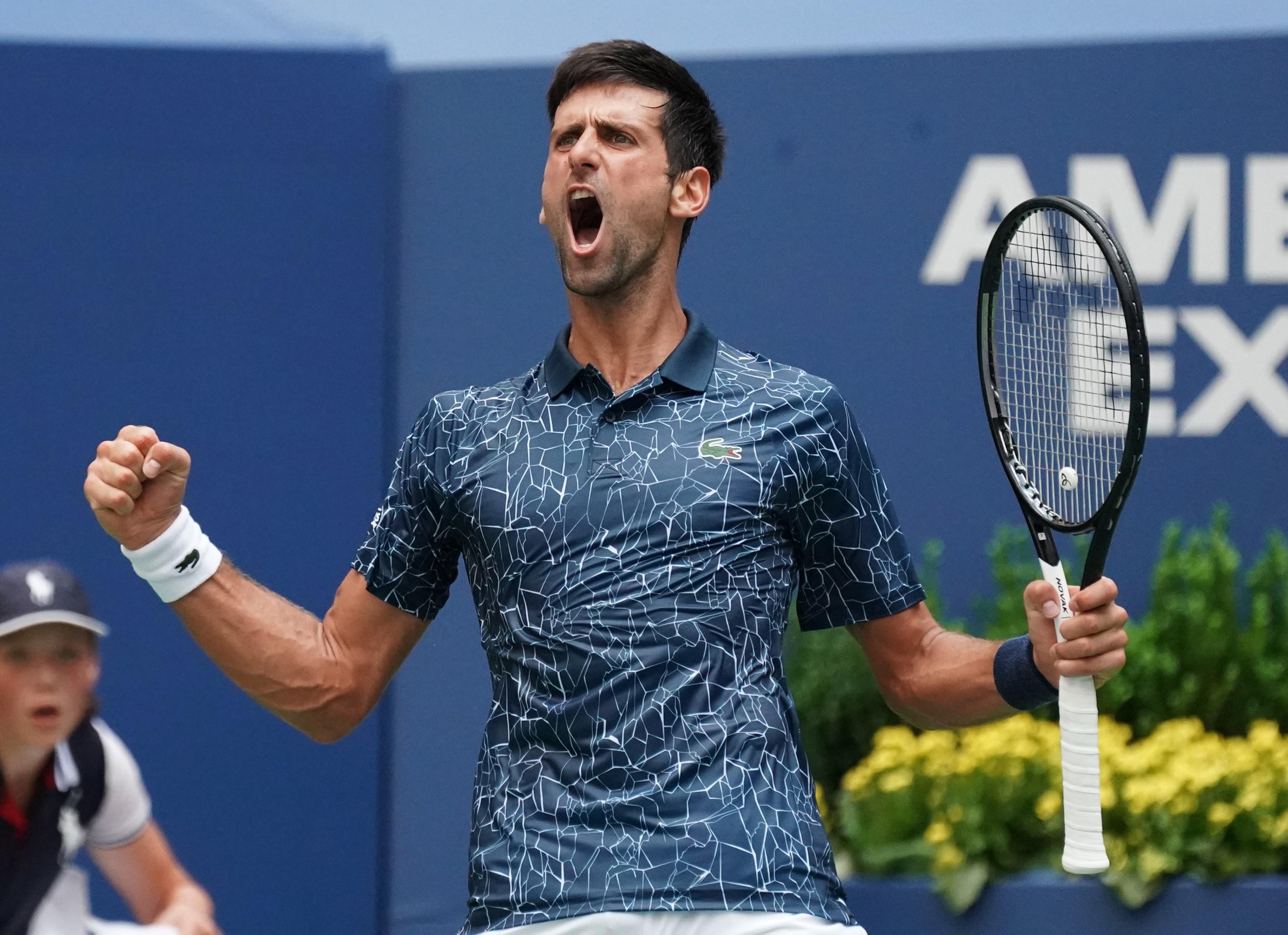 Novak Djokovic celebrates during his four-set win on Tuesday