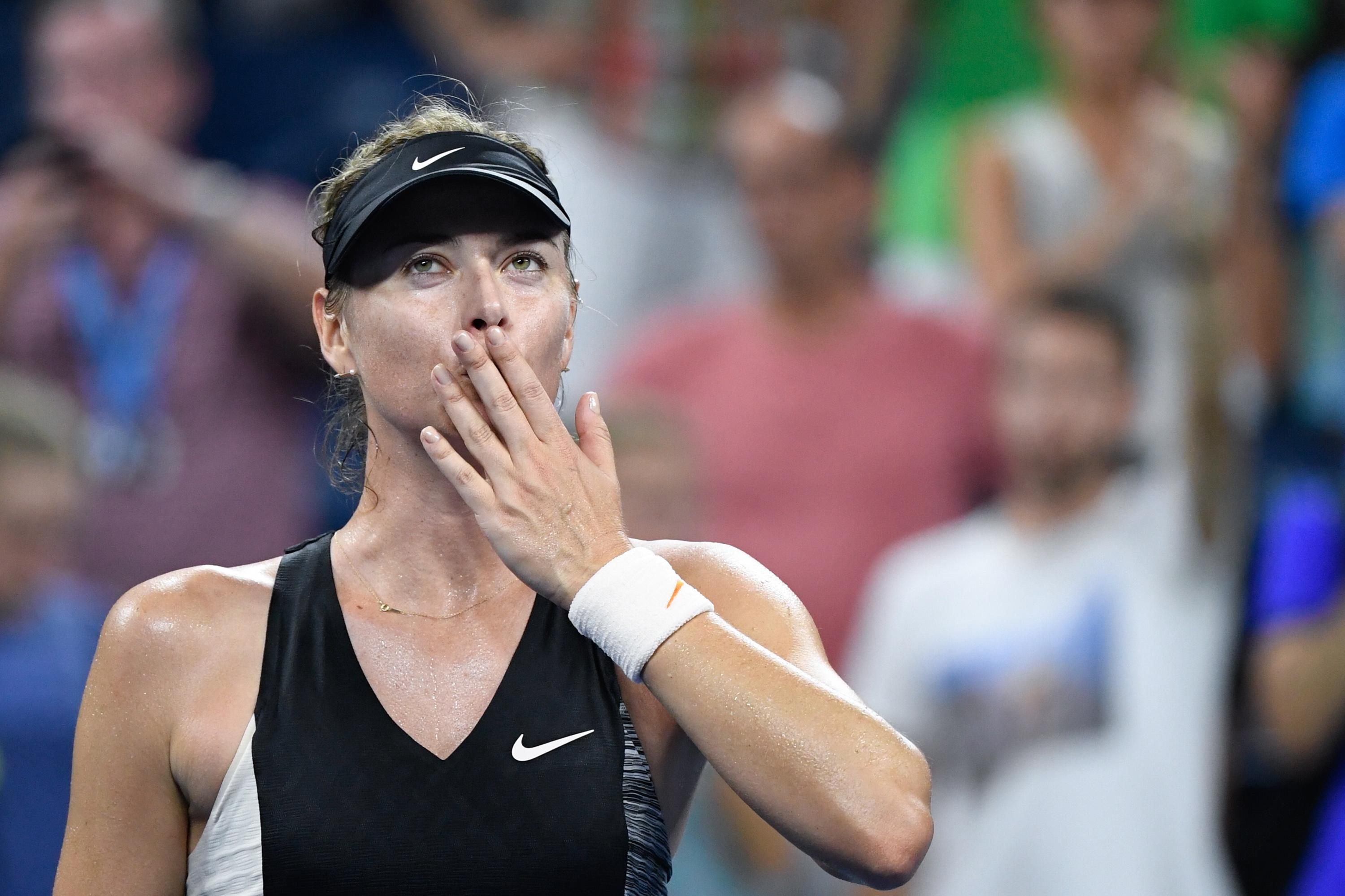 Maria Sharapova blows a kiss to the crowd after defeating Patty Schnyder