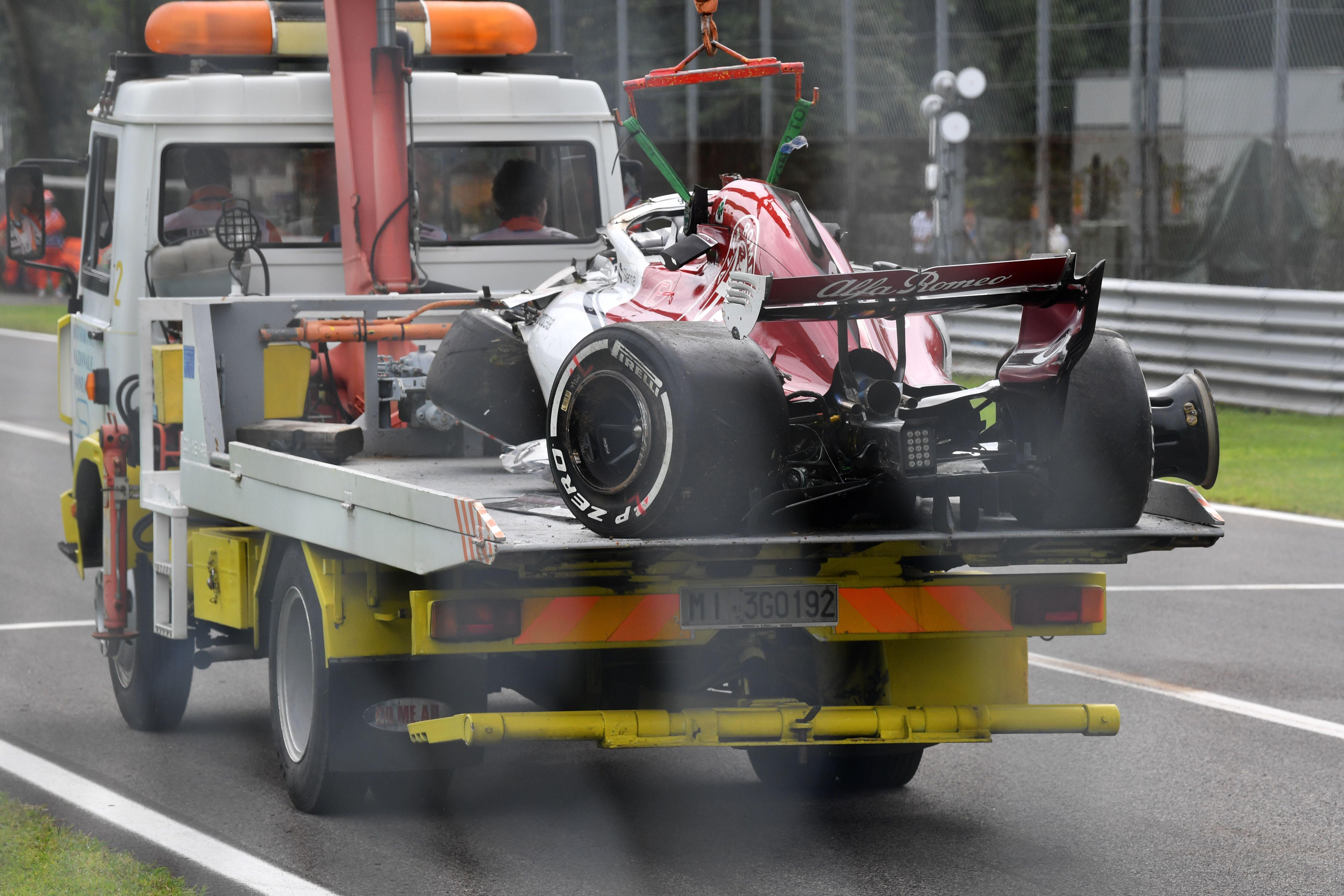 The decimated Sauber is taken away from the track