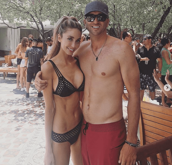 Sam Maddox poses with fiance Austin Johnson, caddy of Dustin Johnson