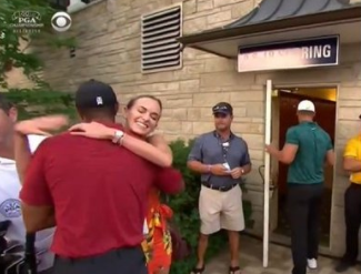 Tiger Woods makes the day for Jena Sims as they both wait for fellow American Brooks Koepka following his superb win in the US PGA Championship in St Louis