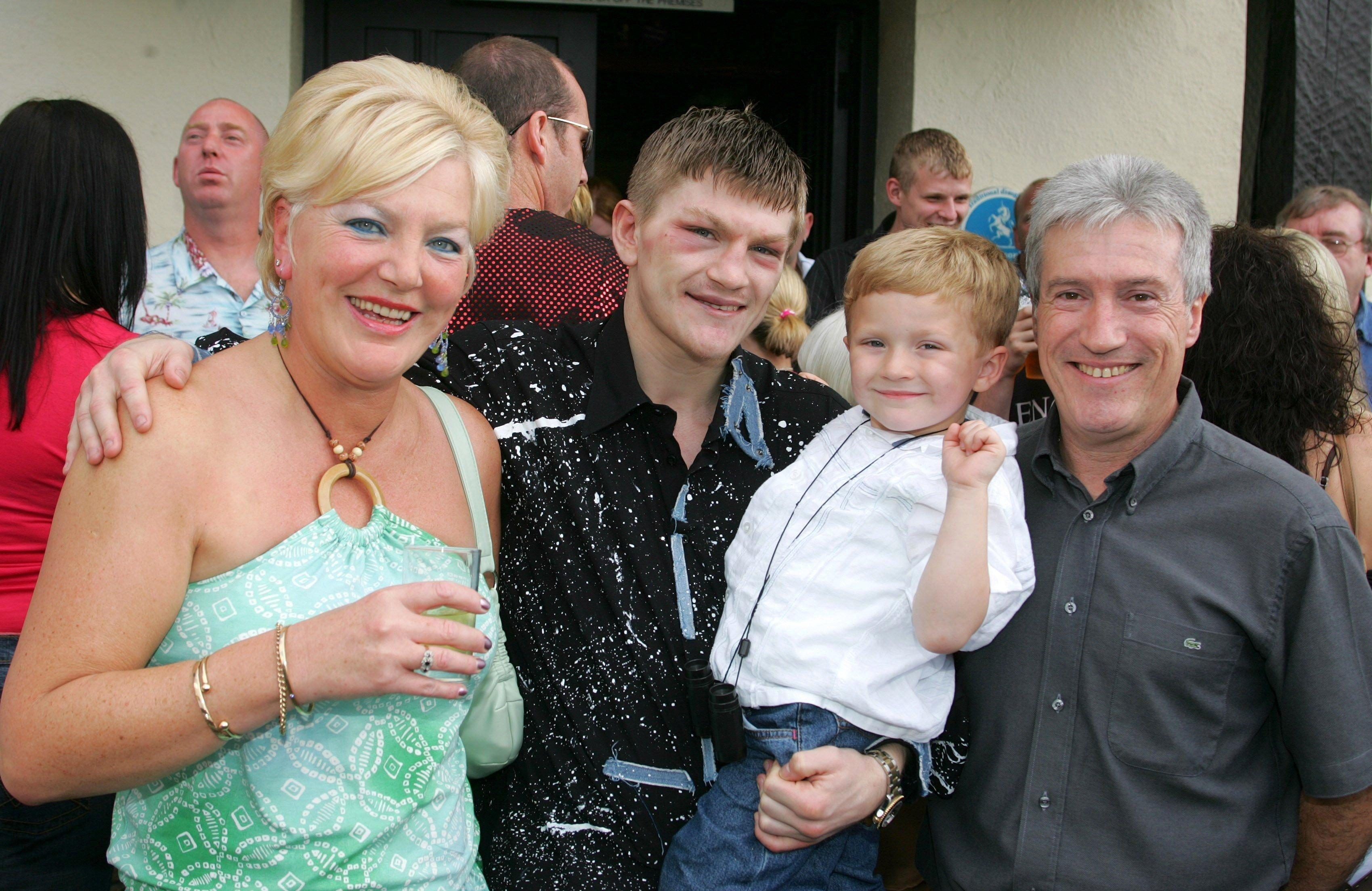 Hatton, holding son Campbell, fell out with his parents Carol and Ray
