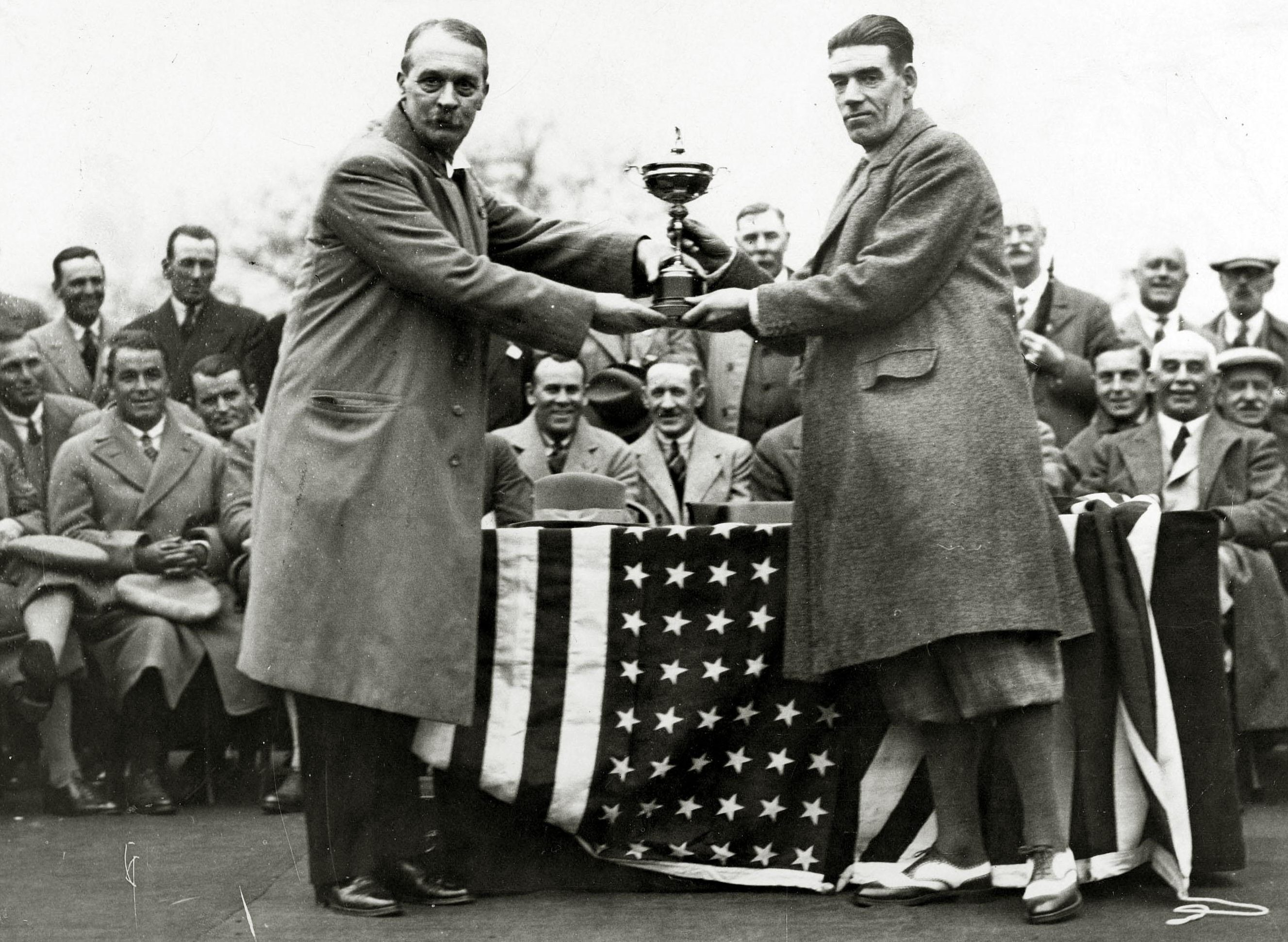 Samuel Ryder, the donor of the Ryder Cup, presents the trophy to winning captain, Great Britain's George Duncan at Moortown in Leeds in 1929