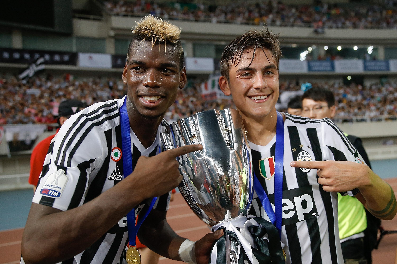 Paul Pogba, left, won four successive Serie A titles at Juventus