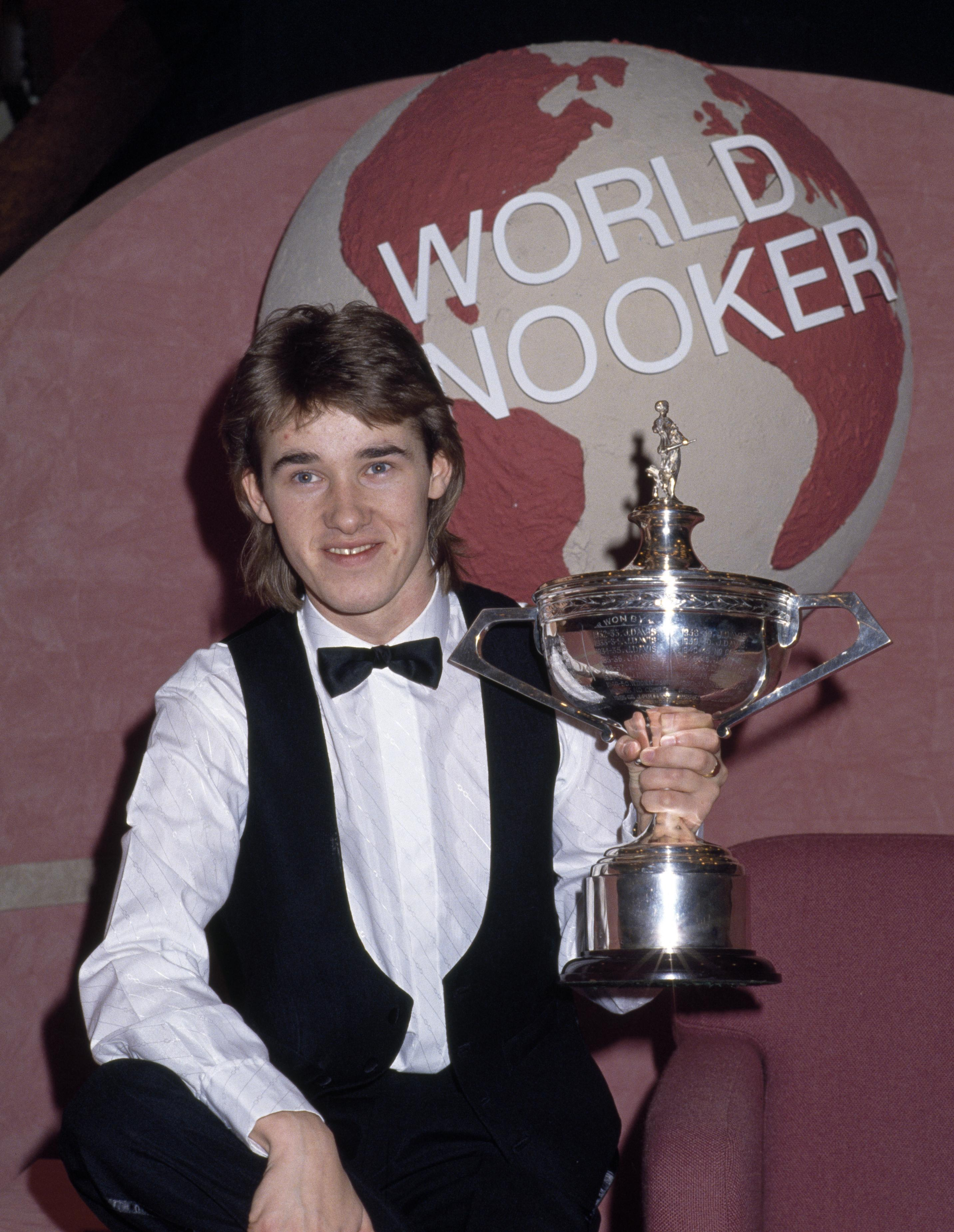 Stephen Hendry won his first World Championship trophy at the age of 21