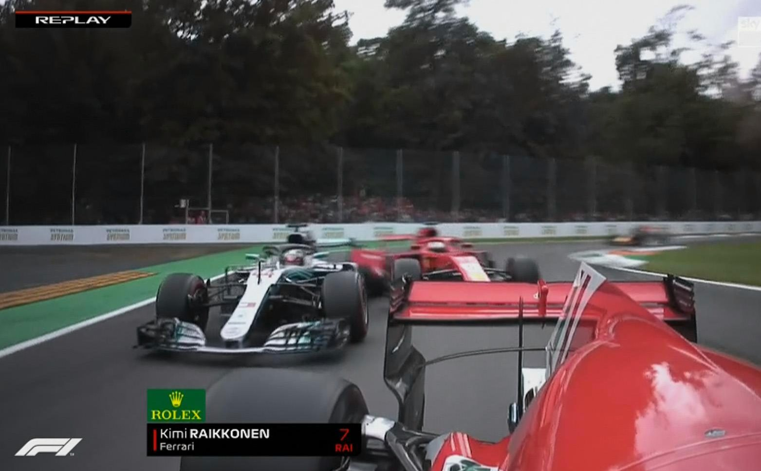 Vettel starts to spin off after his contact with the Mercedes of Hamilton