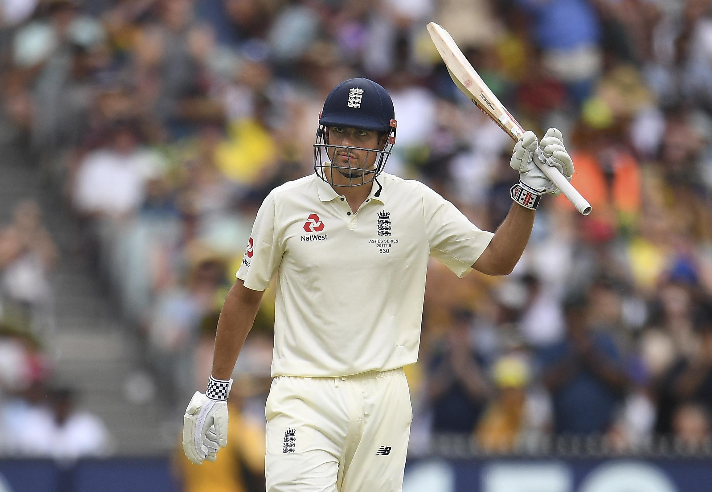 Cook celebrates reaching 150 on day three of the Boxing Day Test during an Ashes whitewash Down Under in the winter