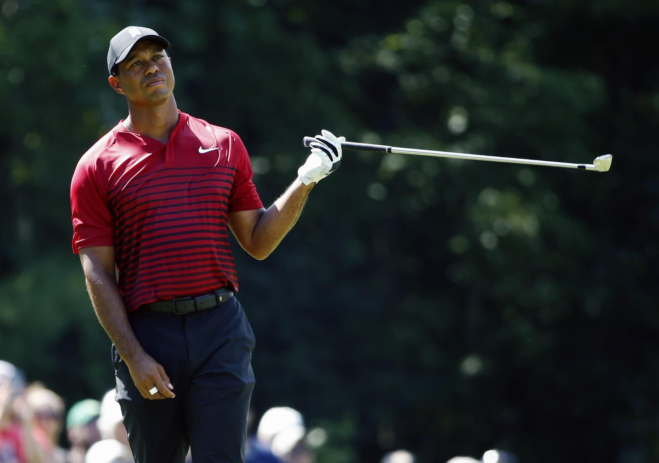 Tiger Woods hit his tee shot into the water on the 16th