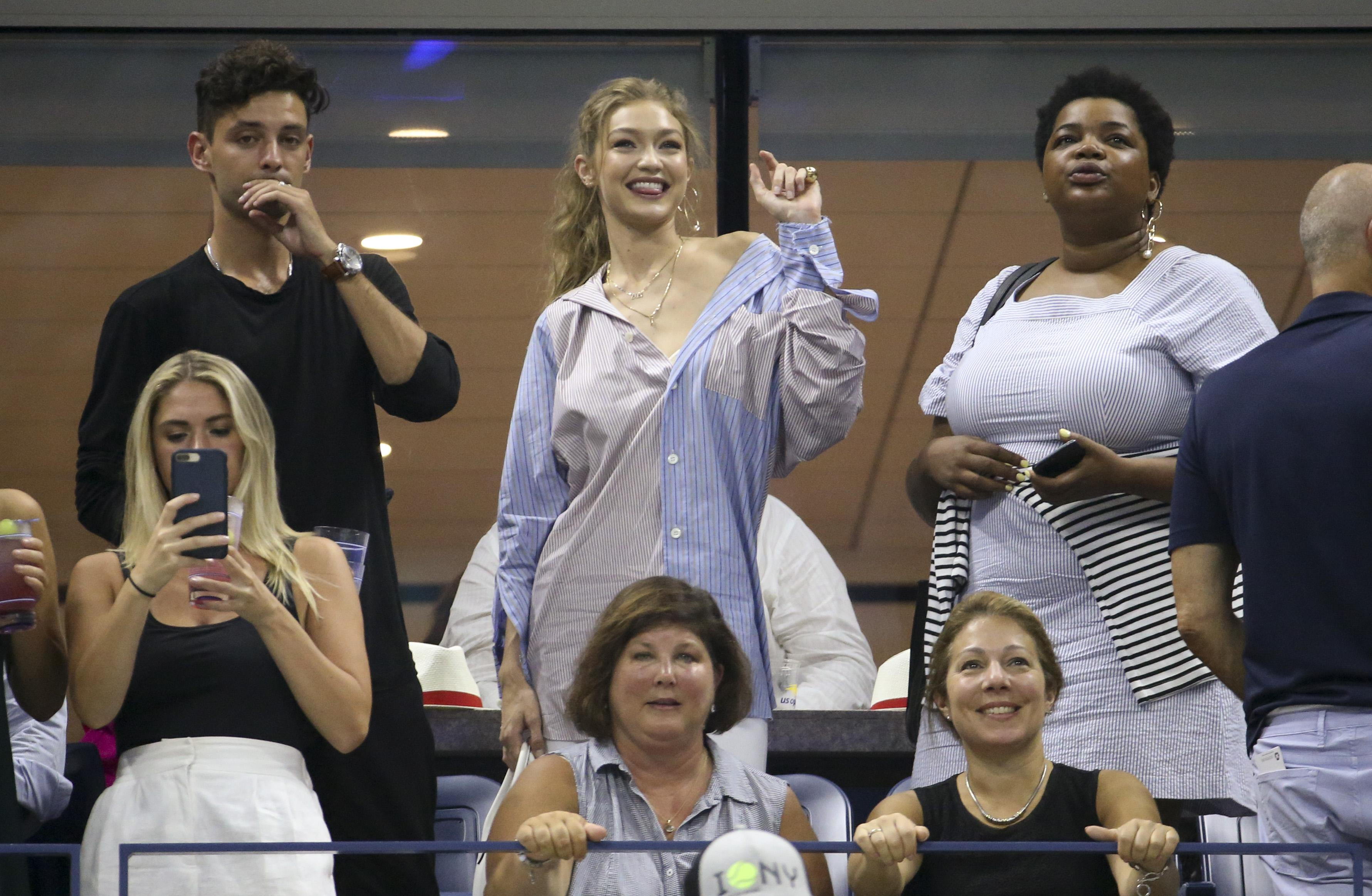 Gigi Hadid looks pleased as Serena Williams storms into the semi-final