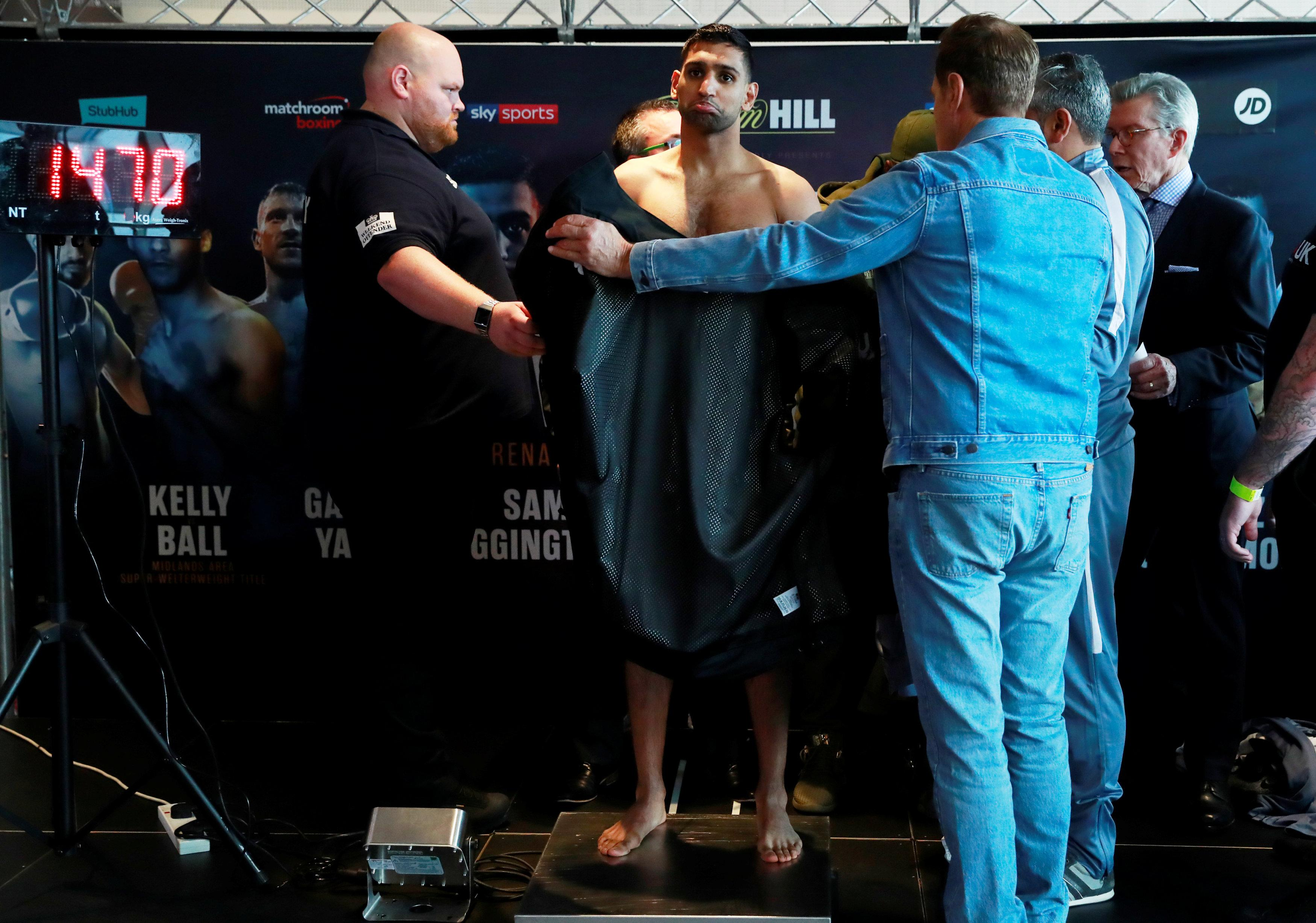 Amir Khan had to get his kit off to make his weight