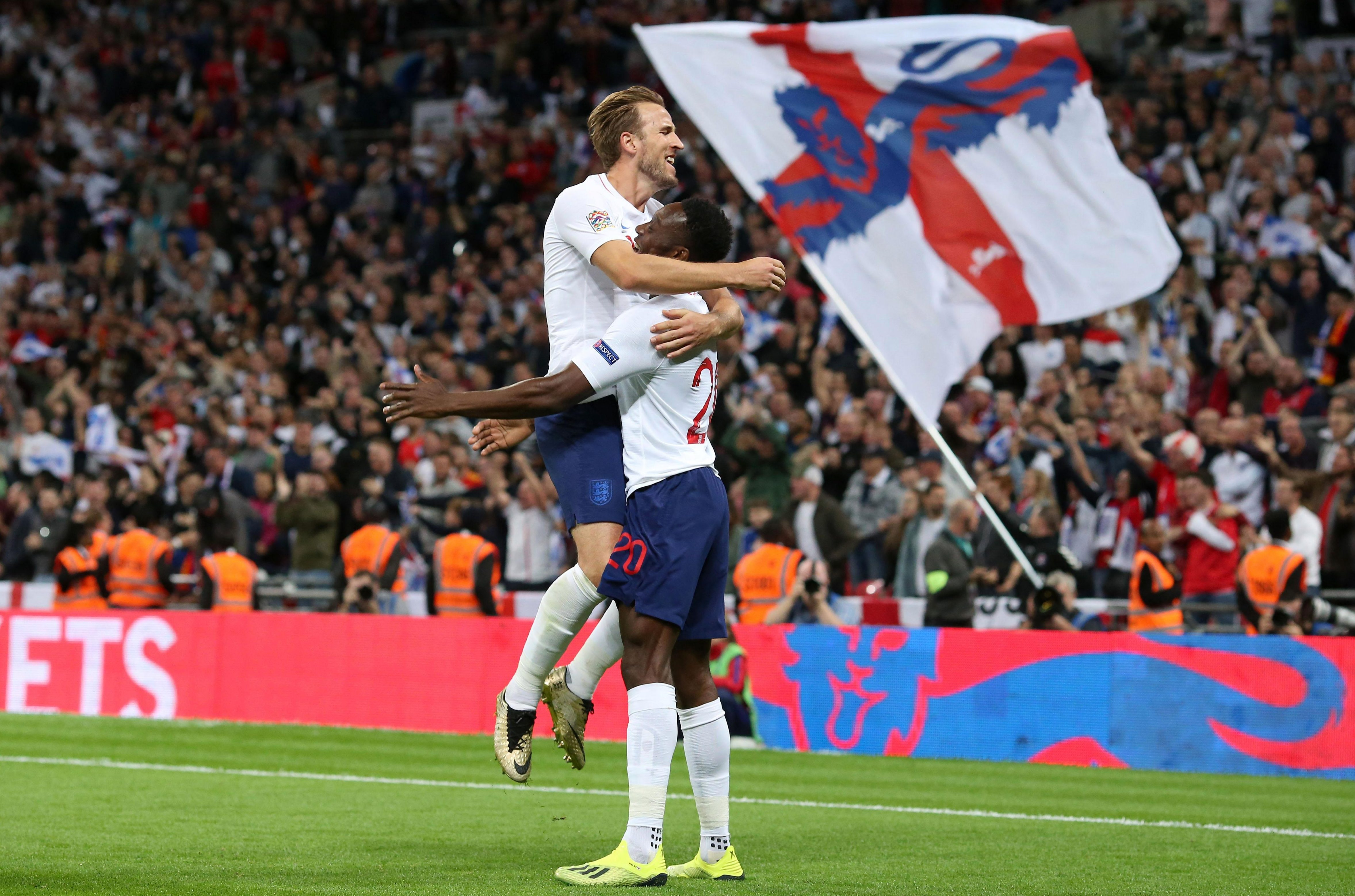 Kane celebrated with Welbeck after he knocked it in - but was pulled back for a foul on David De Gea