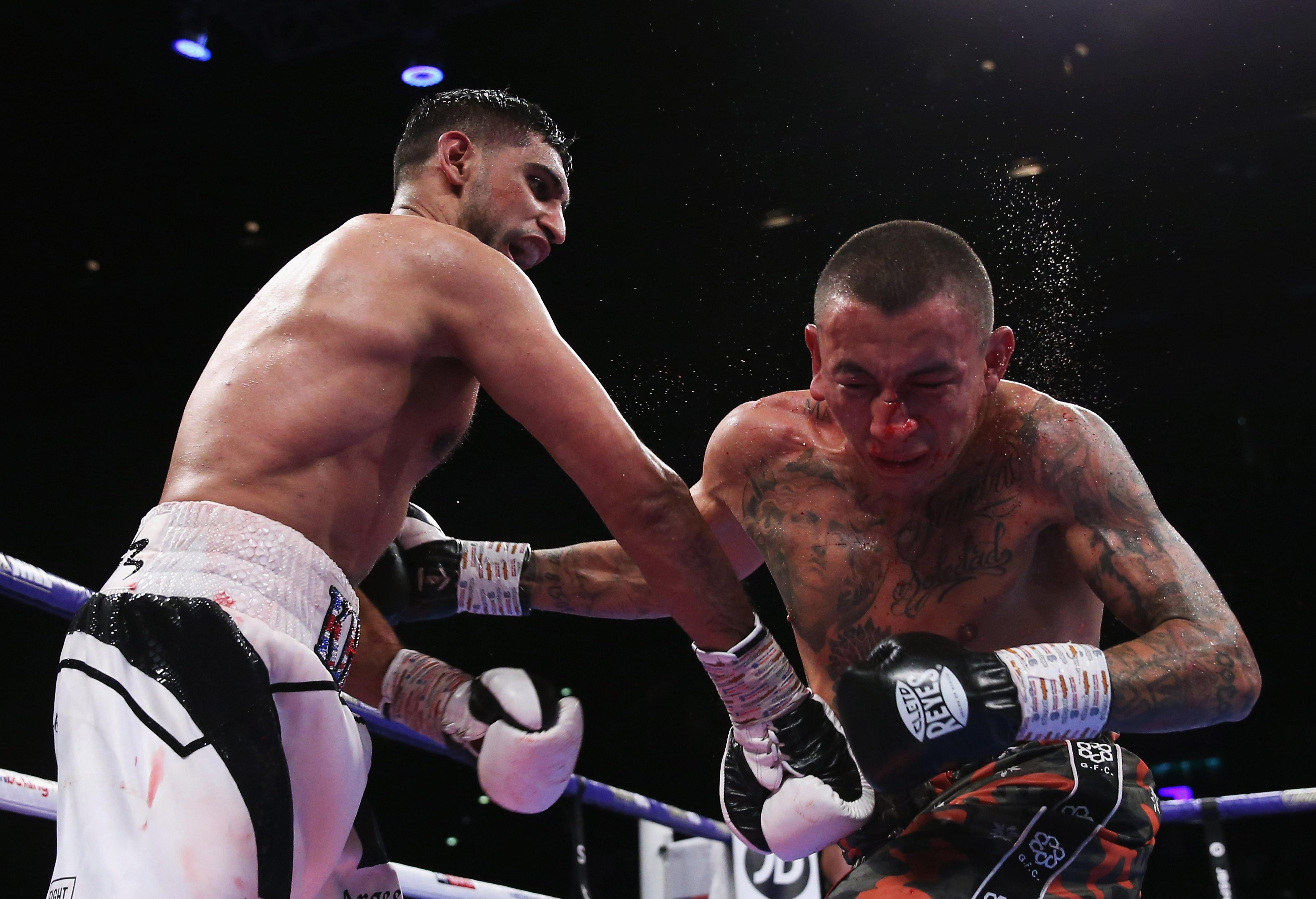 Amir Khan came up off the canvas to edge past Samuel Vargas on points in Birmingham