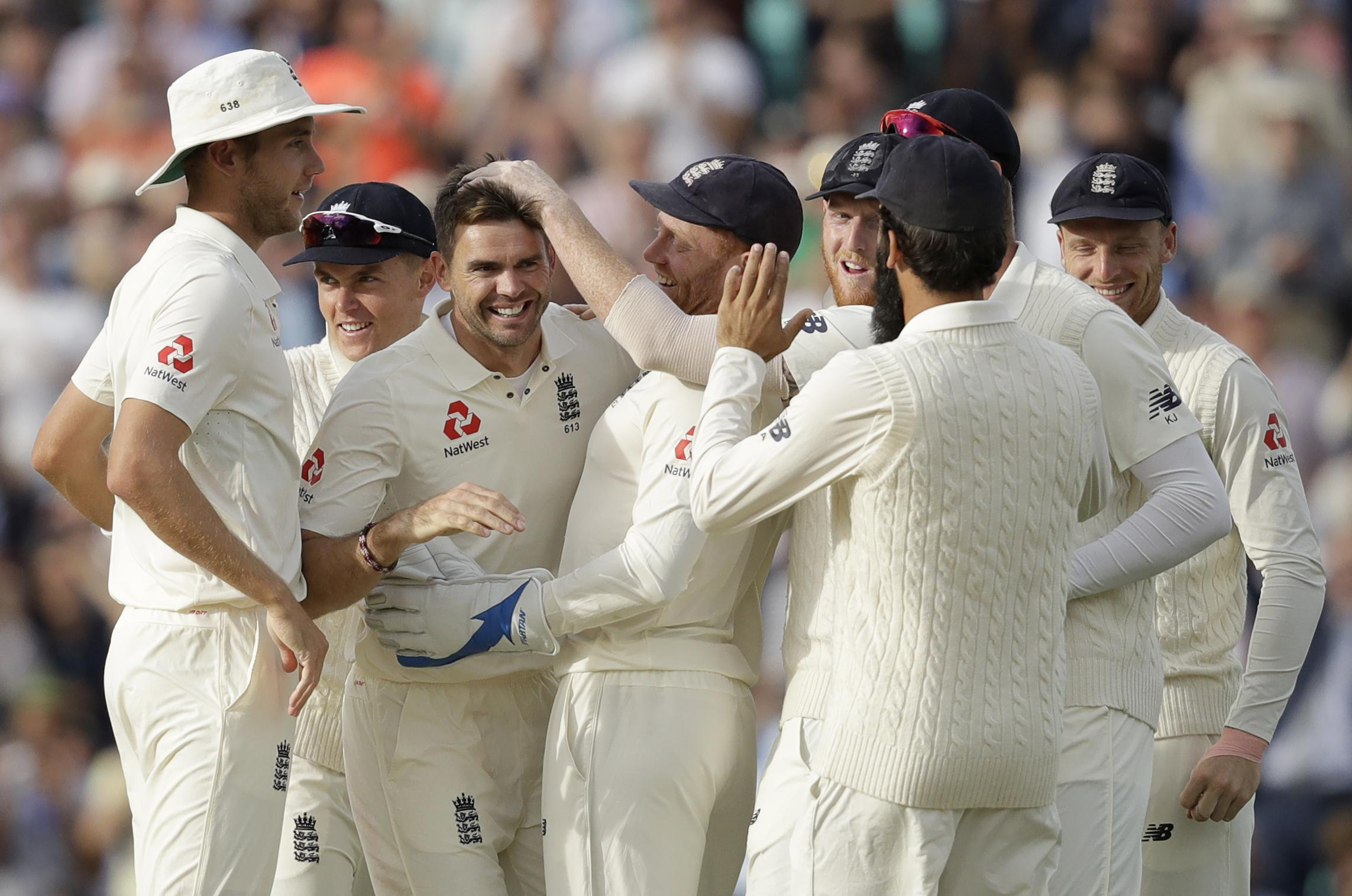 Jimmy Anderson celebrated with his team-mates after his heroic performance at the Oval
