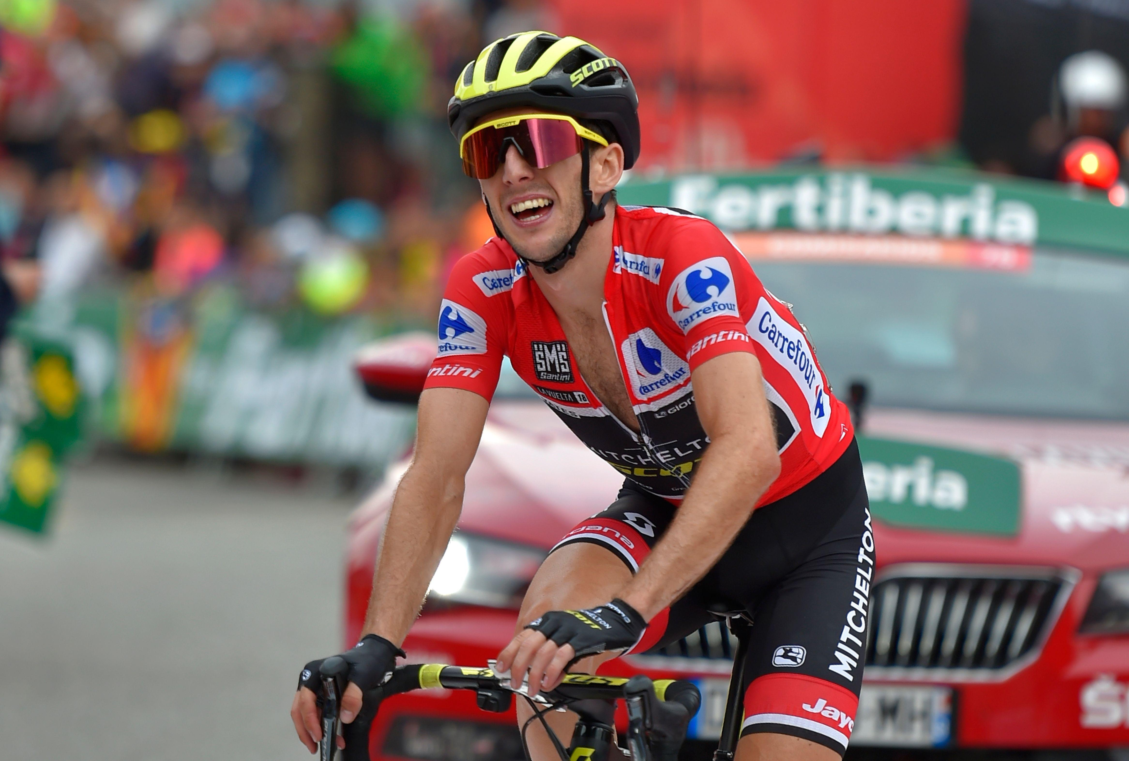 Simon Yates celebrates after crossing the line on stage 20 of La Vuelta to all-but clinch the title