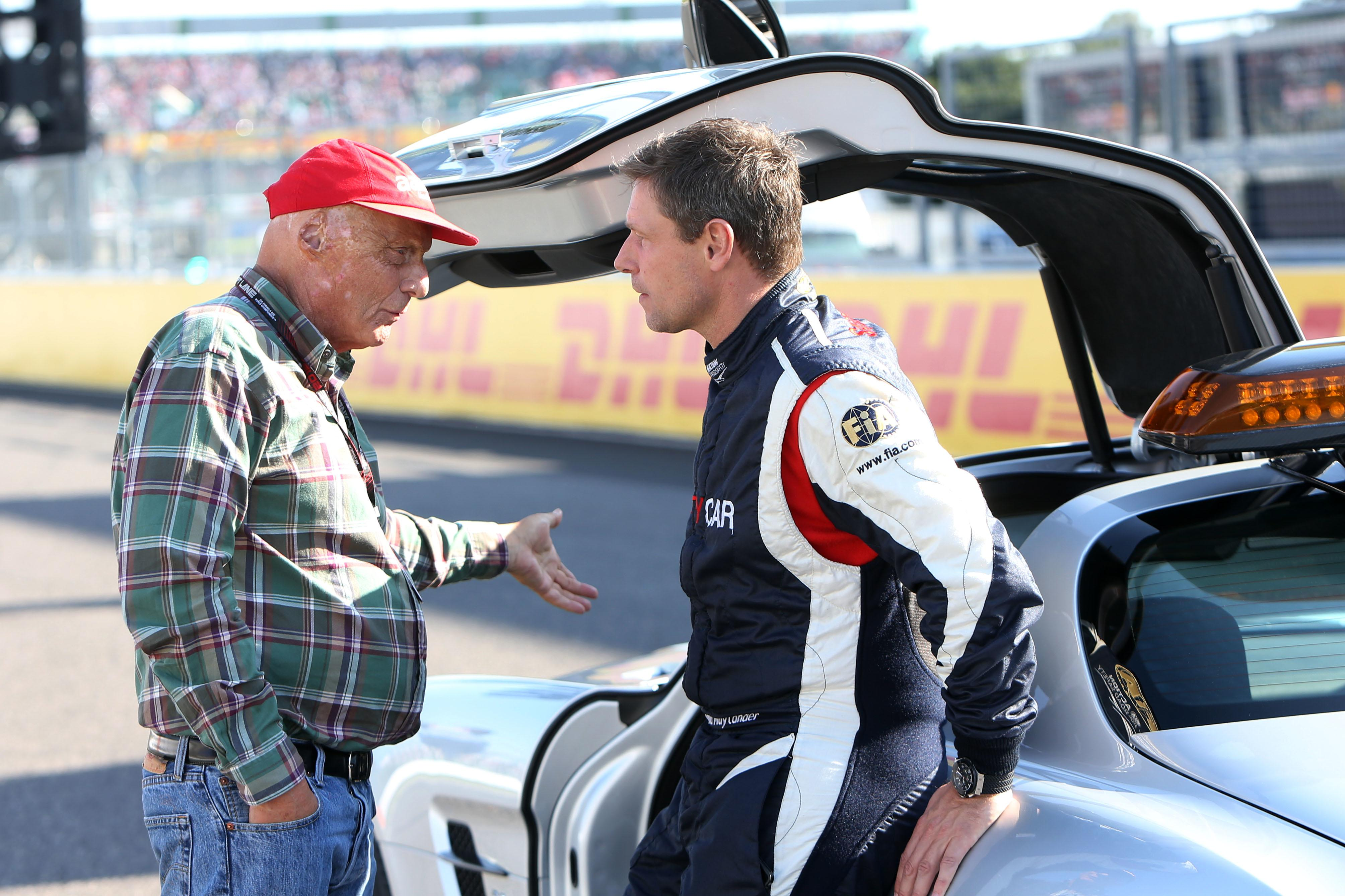 Bernd Maylander chats with F1 legend Niki Lauda on grid