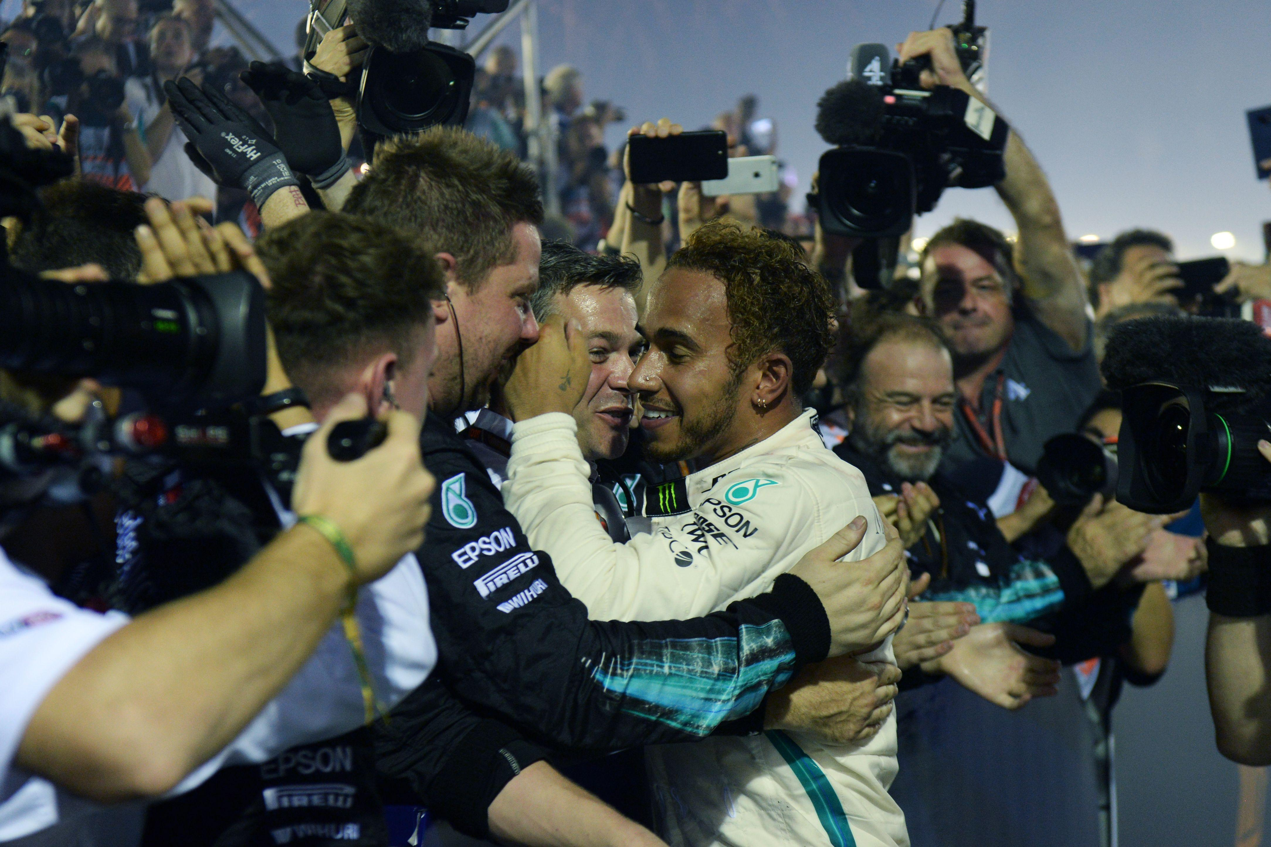 The Mercedes star greets his team at the end of the race he dominated