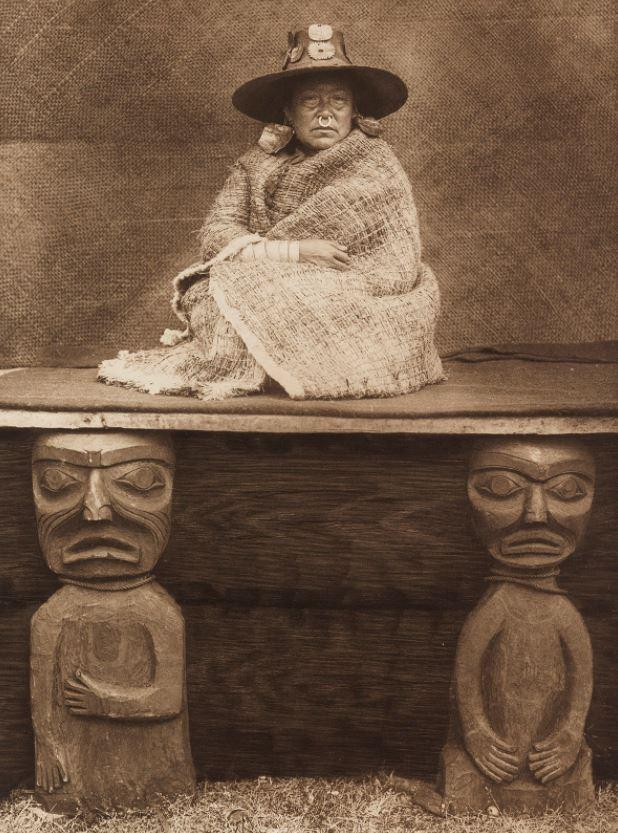This image shows a tribeswoman sitting on a traditional table
