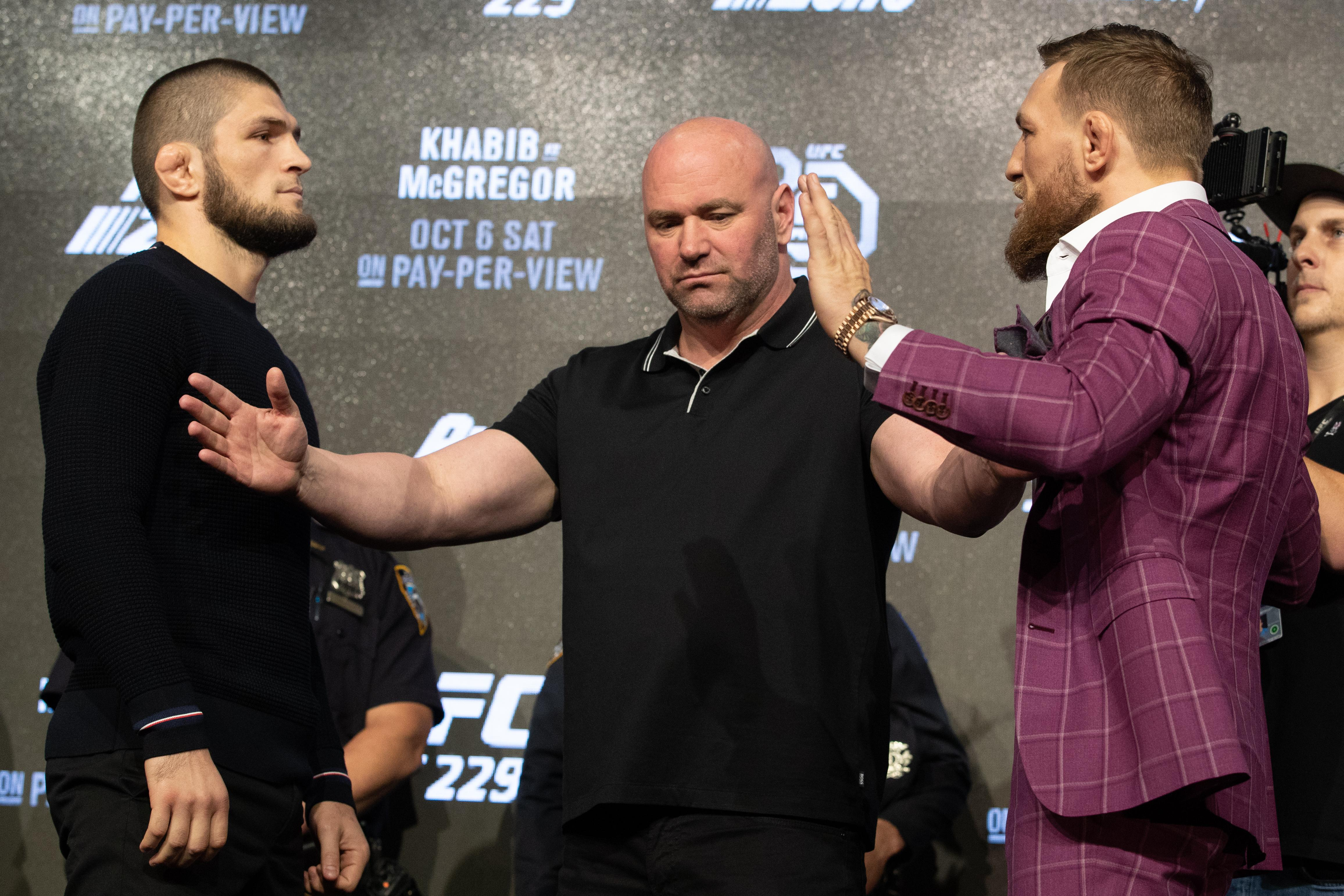 Dana White (centre) says he has invited both Vladimir Putin and Donald Trump to be his VIP guests when Conor McGregor (right) and Khabib Nurmagomedov (left)